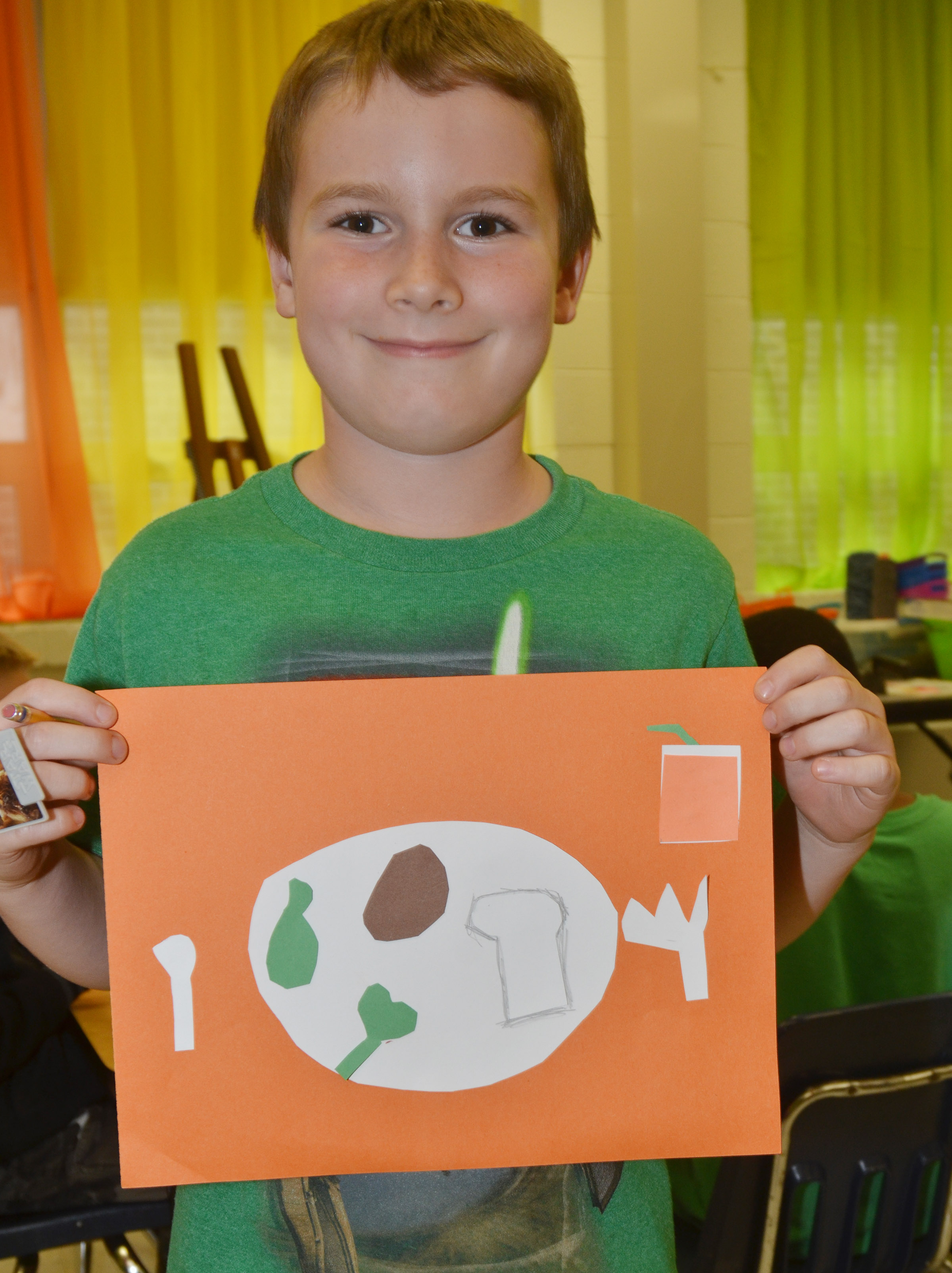 CES third-grader Stephen Green holds his finished drawing.