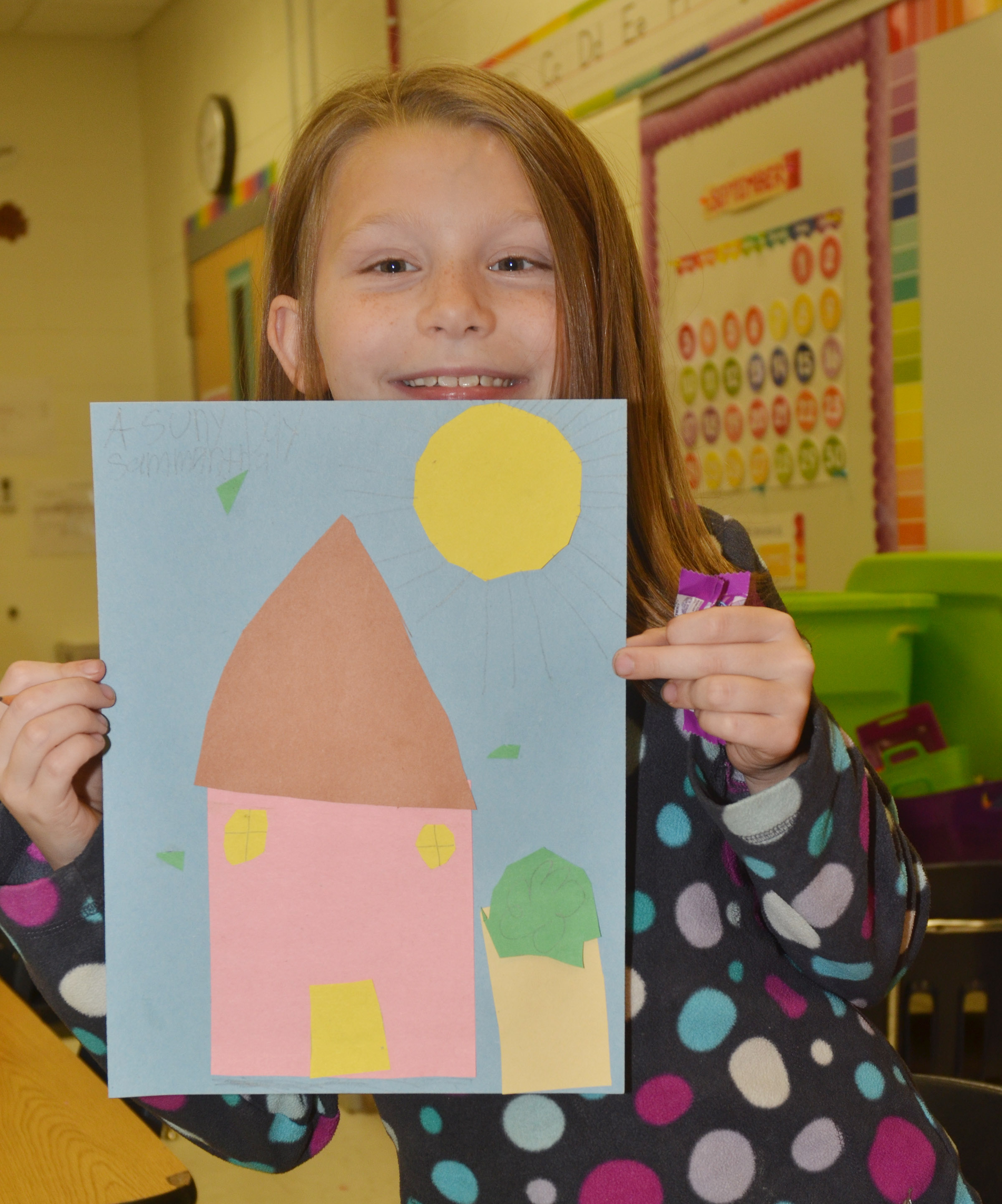 CES third-grader Sammantha Wooley holds her finished drawing.