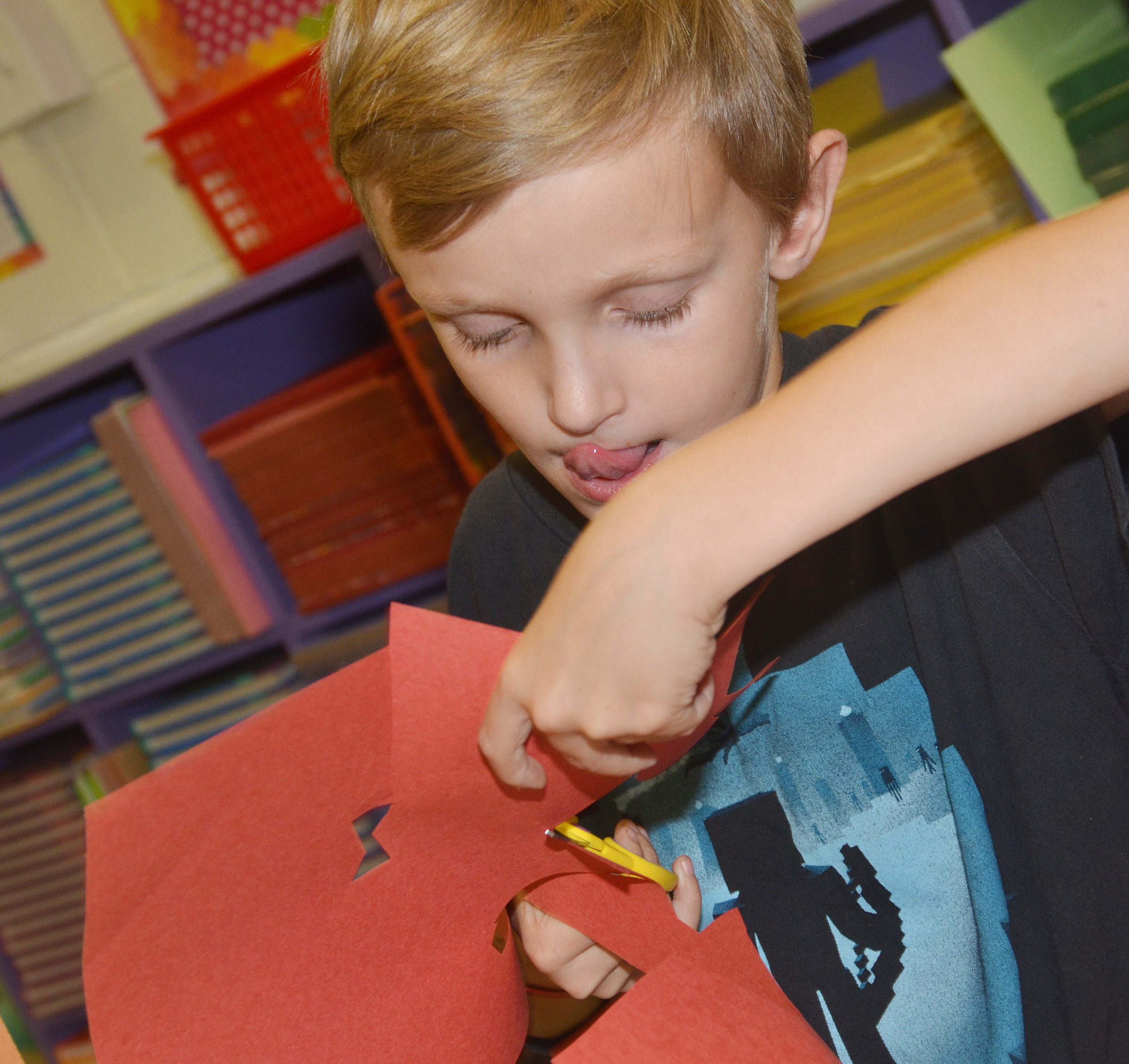 CES third-grader Aaron Ritchie cuts out shapes as he creates his drawing.