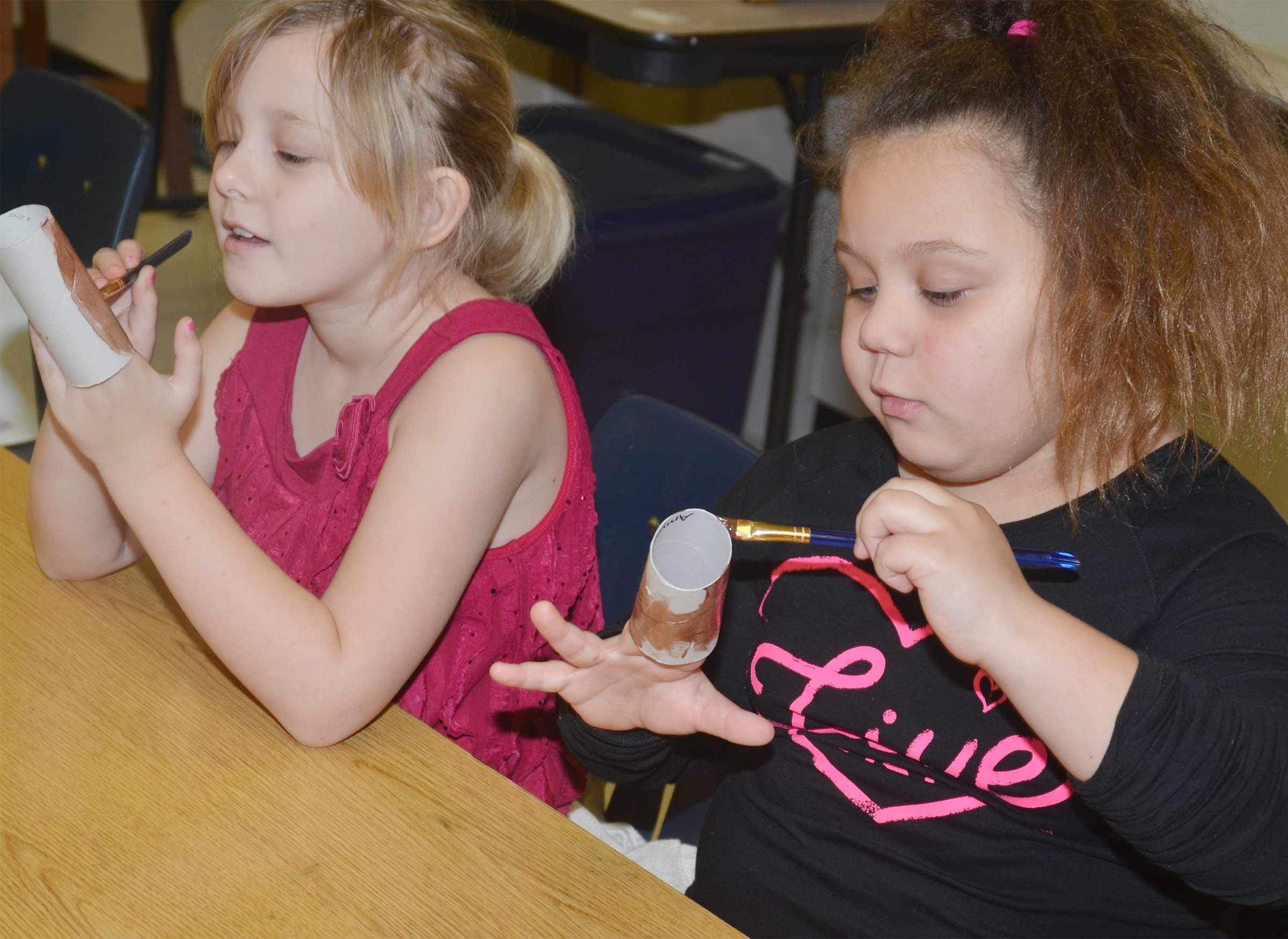 CES first-graders Allison Dean, at left, and Amylah Taylor paint.