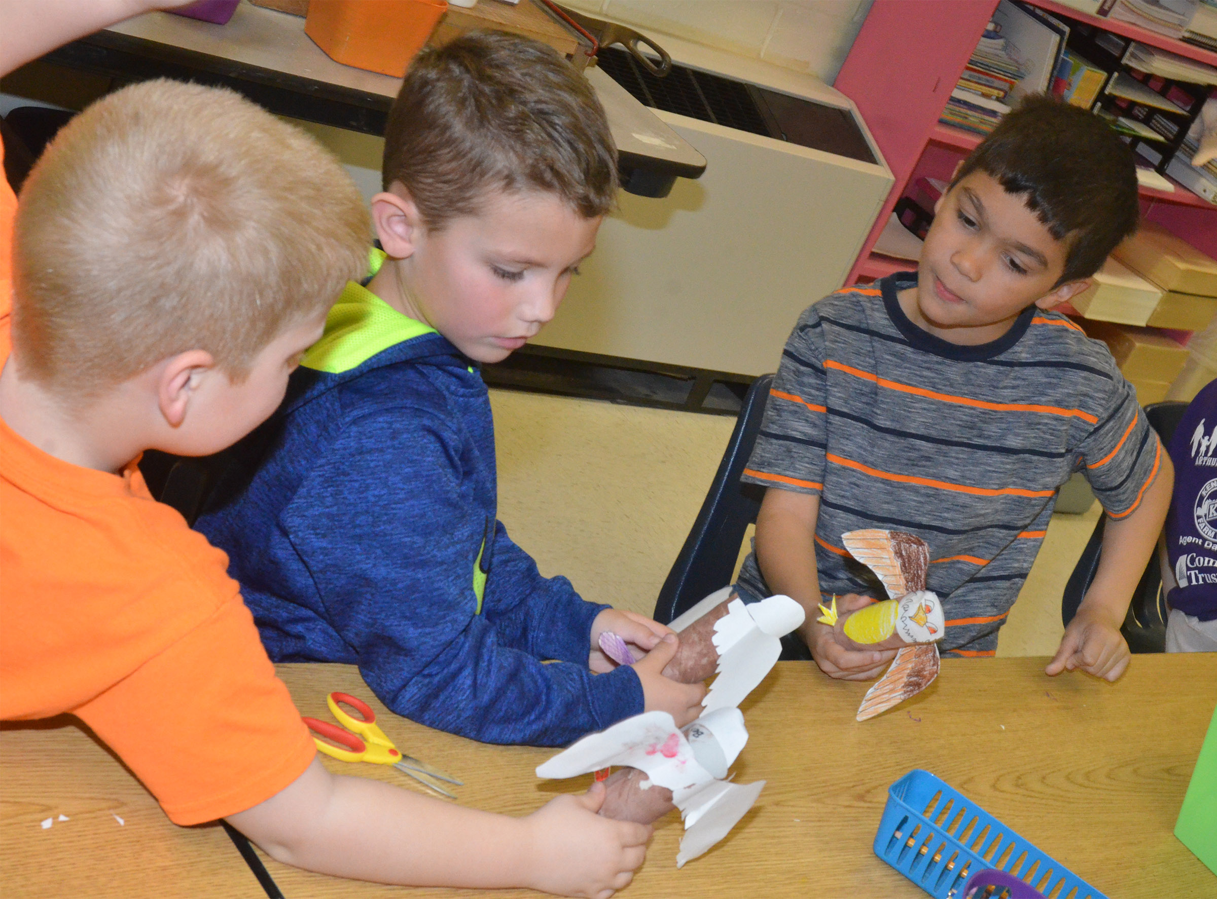 From left, CES first-graders Ben Parrott, Owen Skaggs and Xadrian Fugate fly their Eagles.