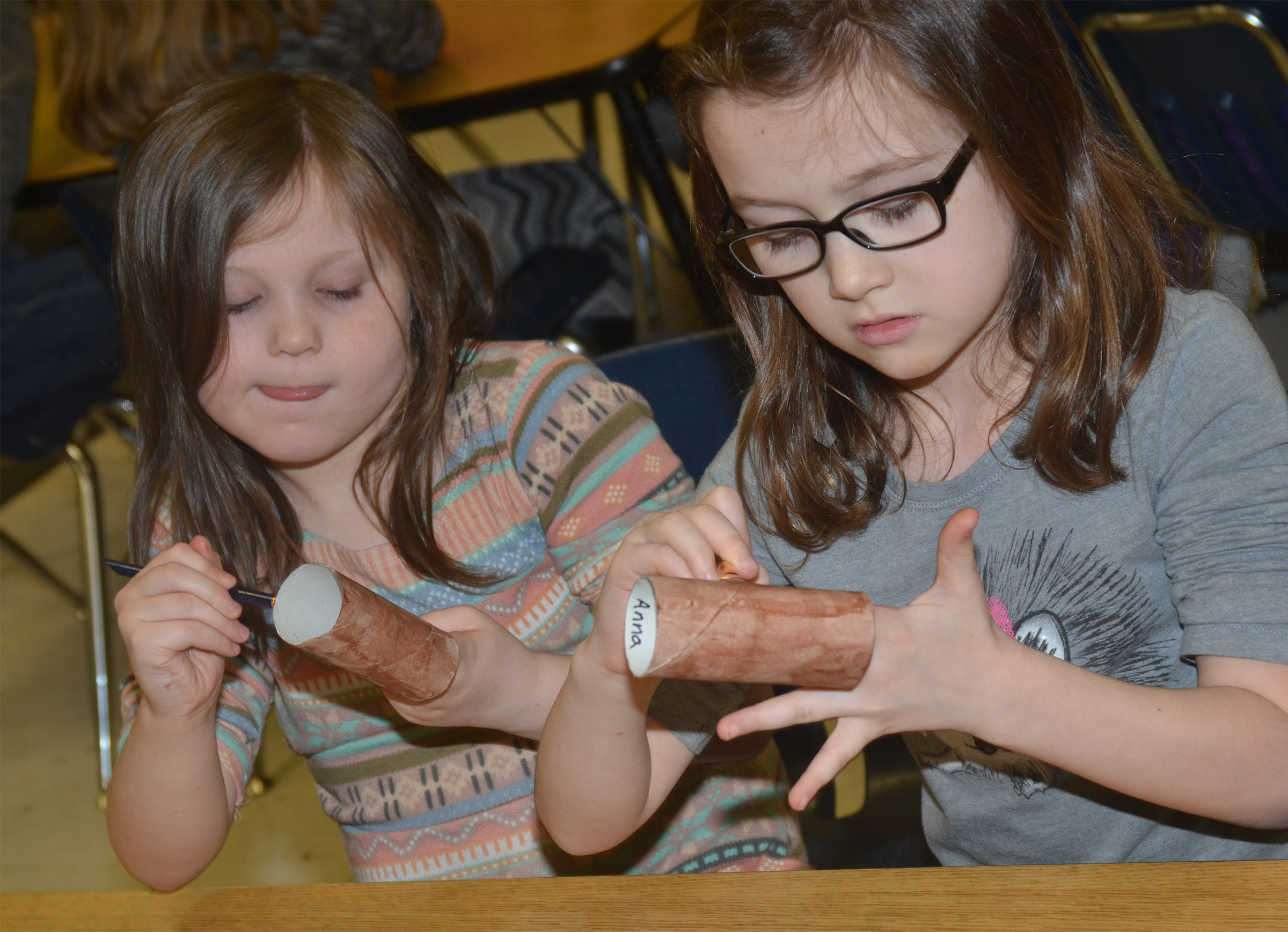 CES first-graders Cadynce Cox, at left, and Anna Keith paint.