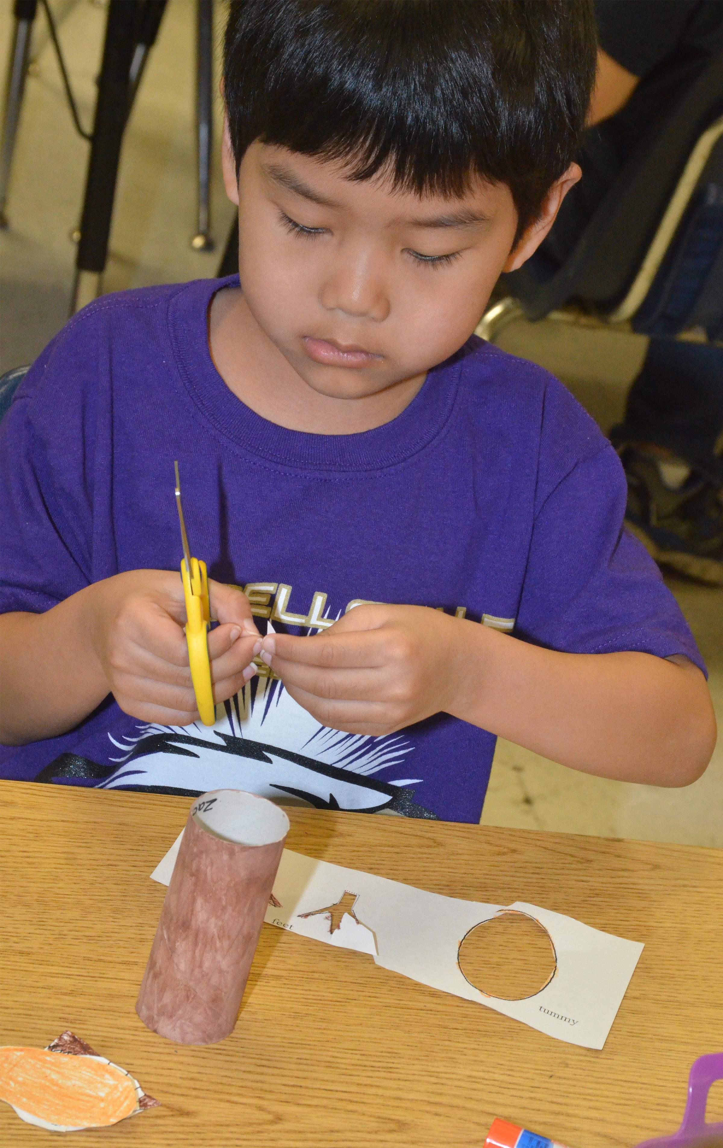 CES first-grader Zach Hak cuts out the pieces to make his Eagle.