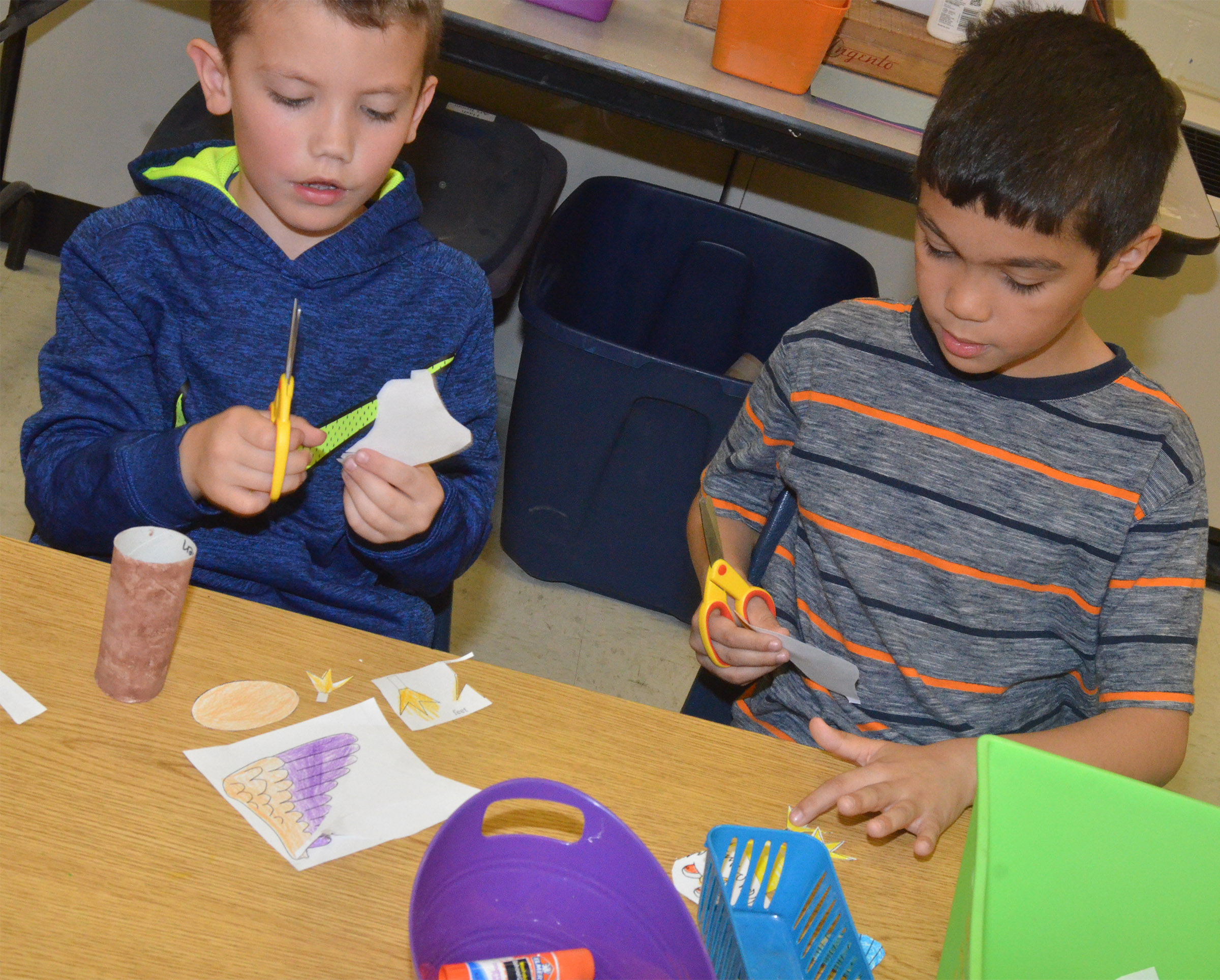 CES first-graders Owen Skaggs, at left, and Xadrian Fugate cut out the pieces to make their Eagles.