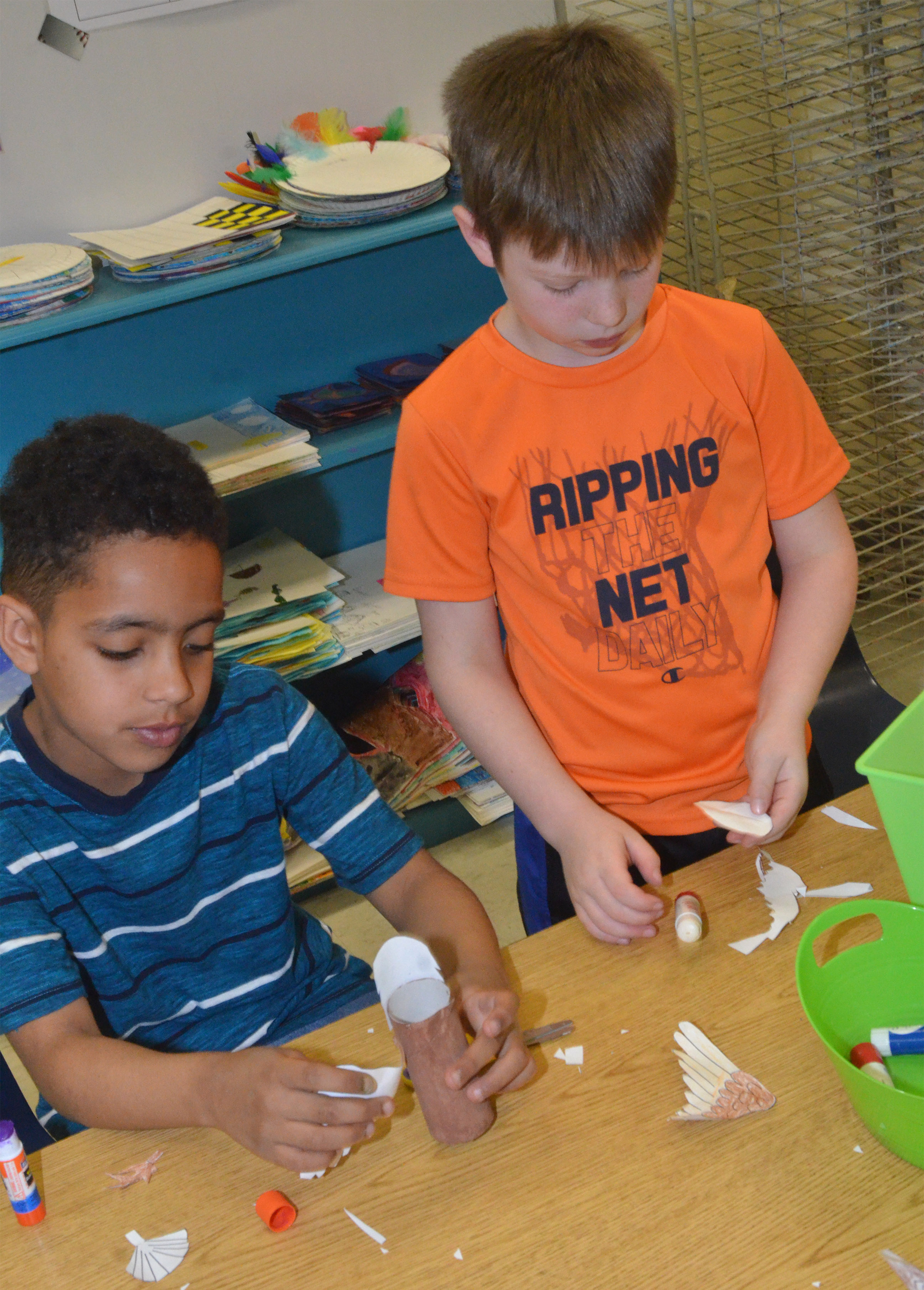 CES first-graders Jo'van Goins, at left, and Brody Sidebottom glue pieces to make their Eagles.