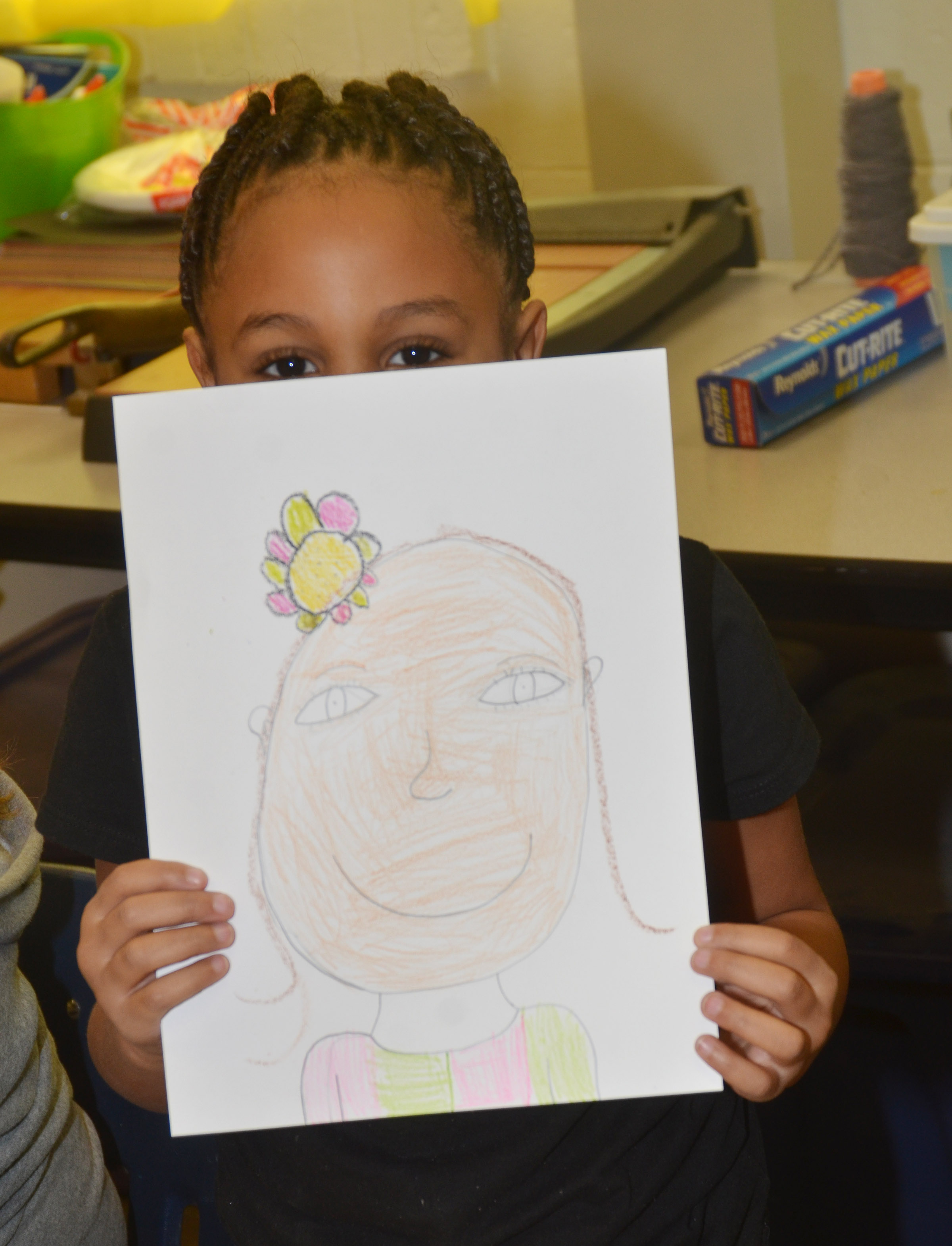 CES second-grader Kadance Ford holds her finished self-portrait.