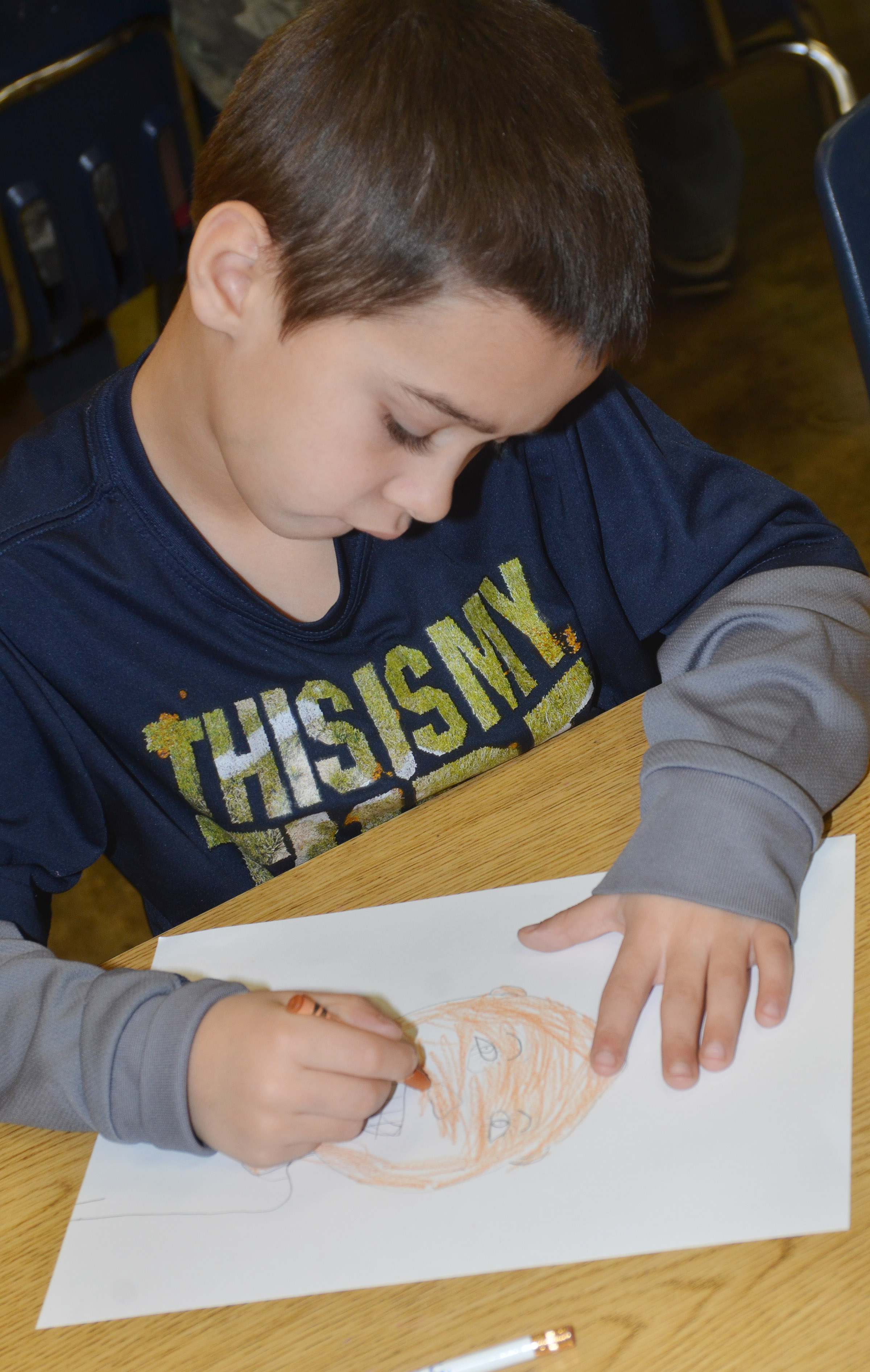 CES second-grader Brenden Chastain colors his self-portrait.