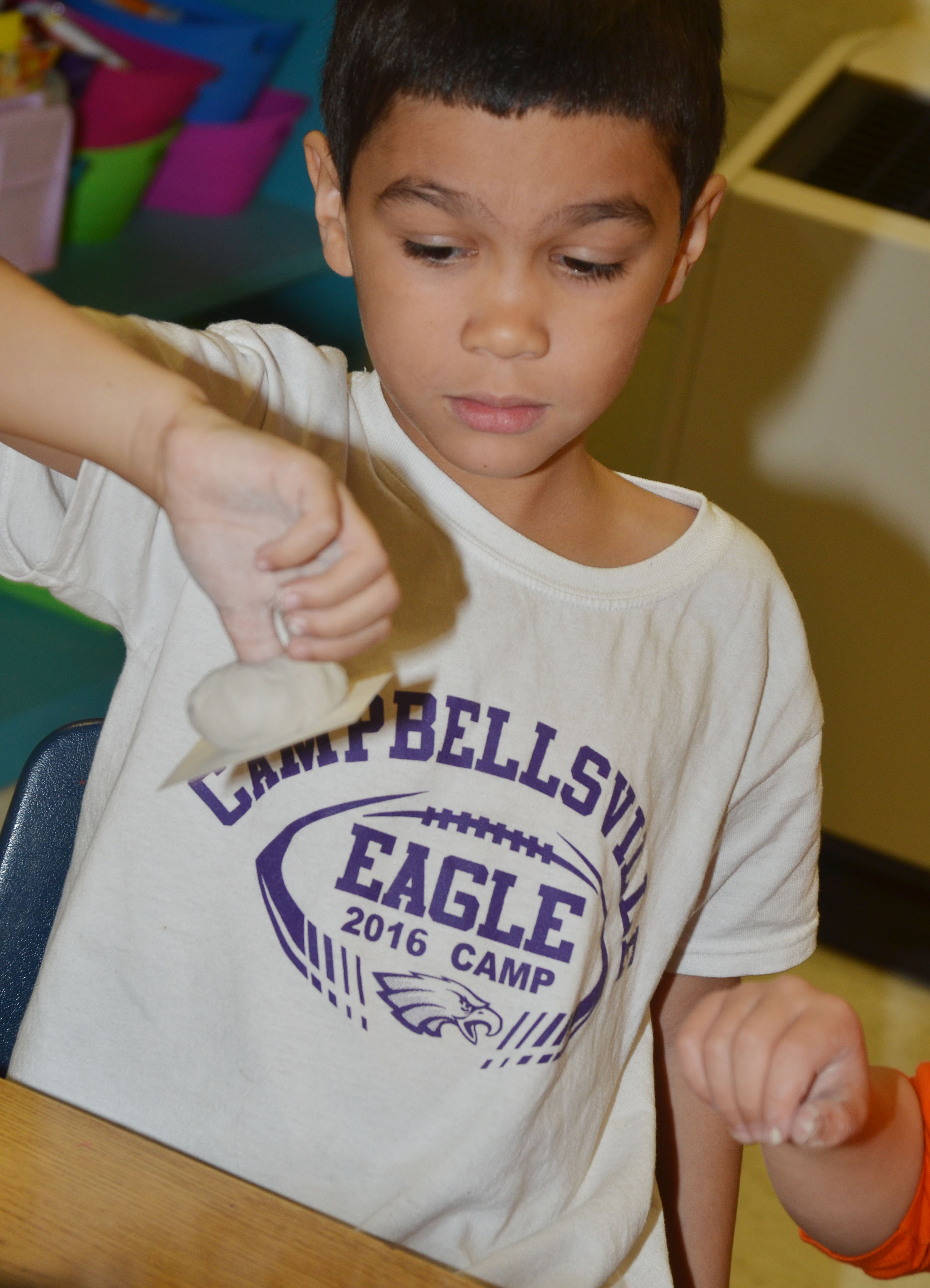 CES first-grader Xadrian Fugate shapes his pot.