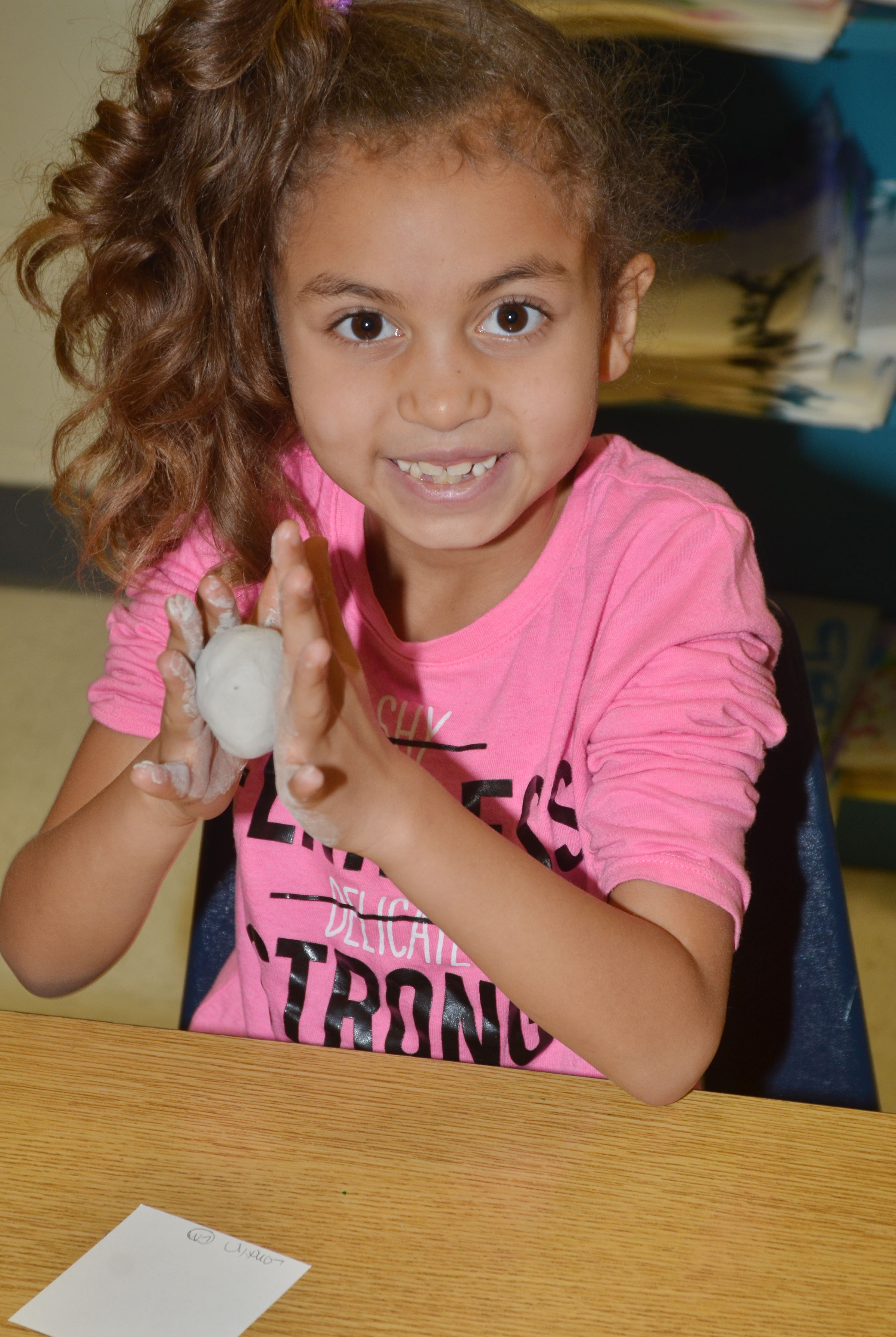 CES first-grader Londyn Smith shapes her pot.