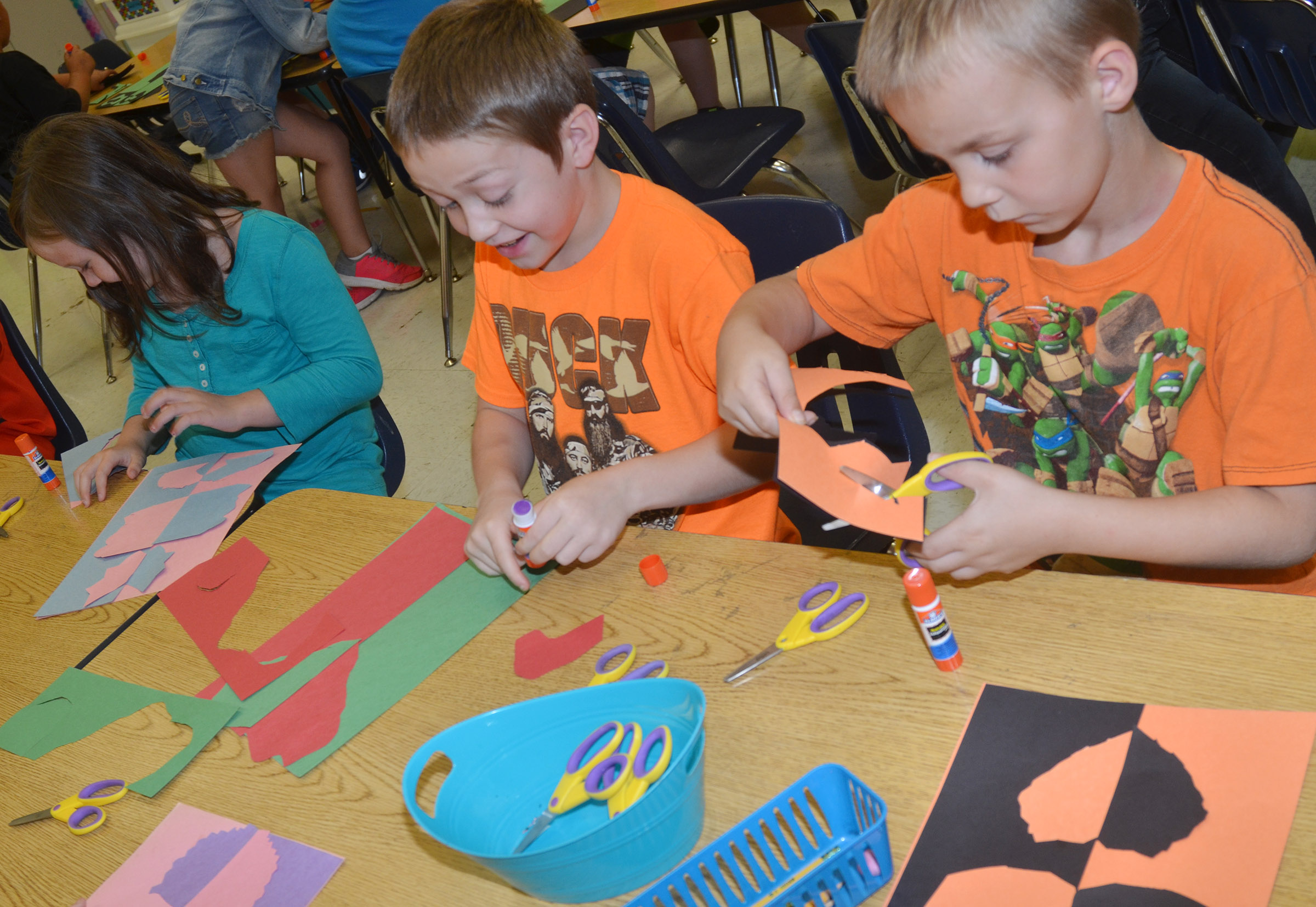 CES second-graders Jacob Golden, at left, and Hunter Bates cut out their free form shapes.
