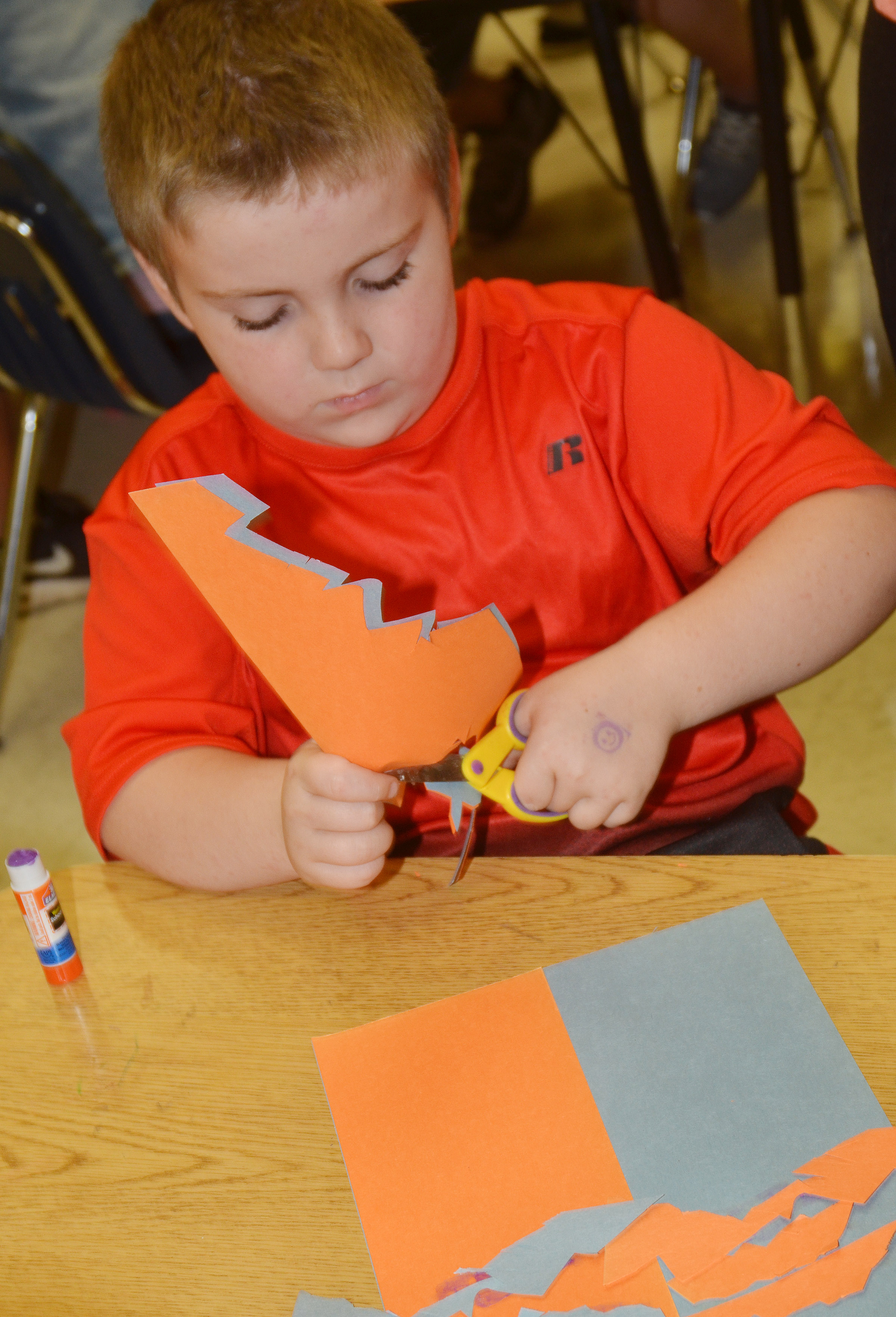 CES second-grader Drake Edwards cuts out his free form shapes.