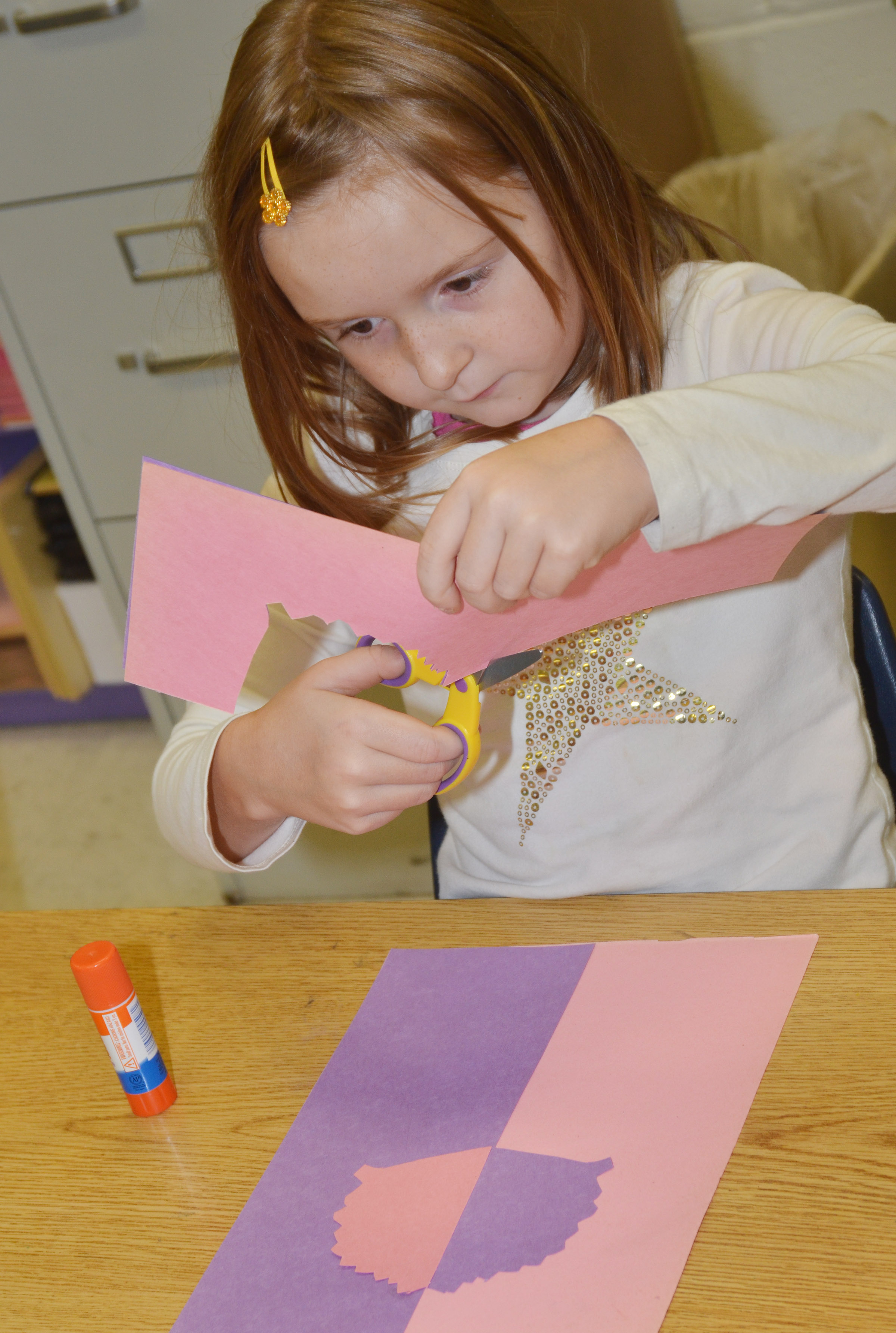 CES second-grader Gracie Murphy cuts out her free form shapes.