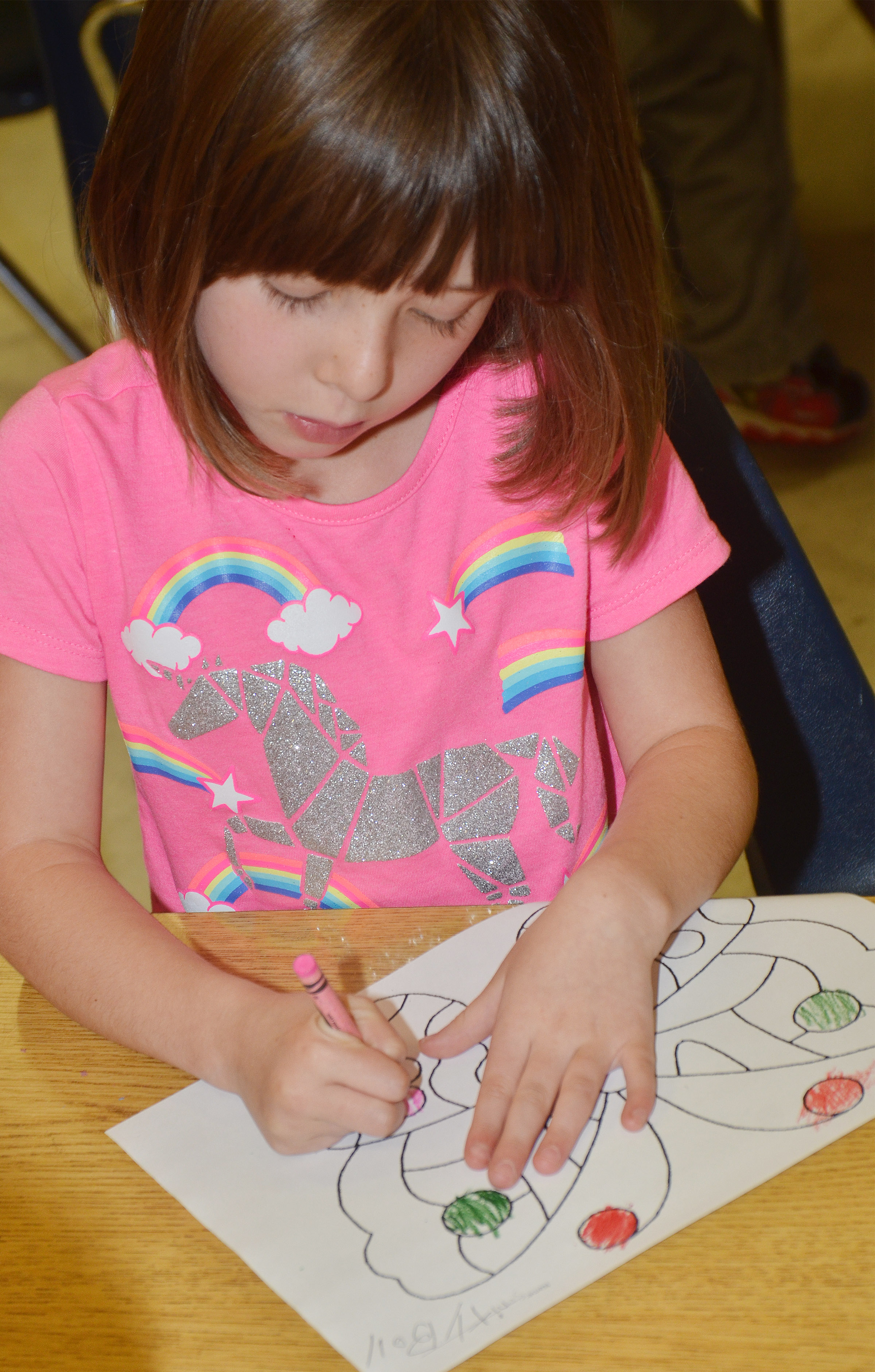 CES kindergartener Serenity Bell colors her butterfly.