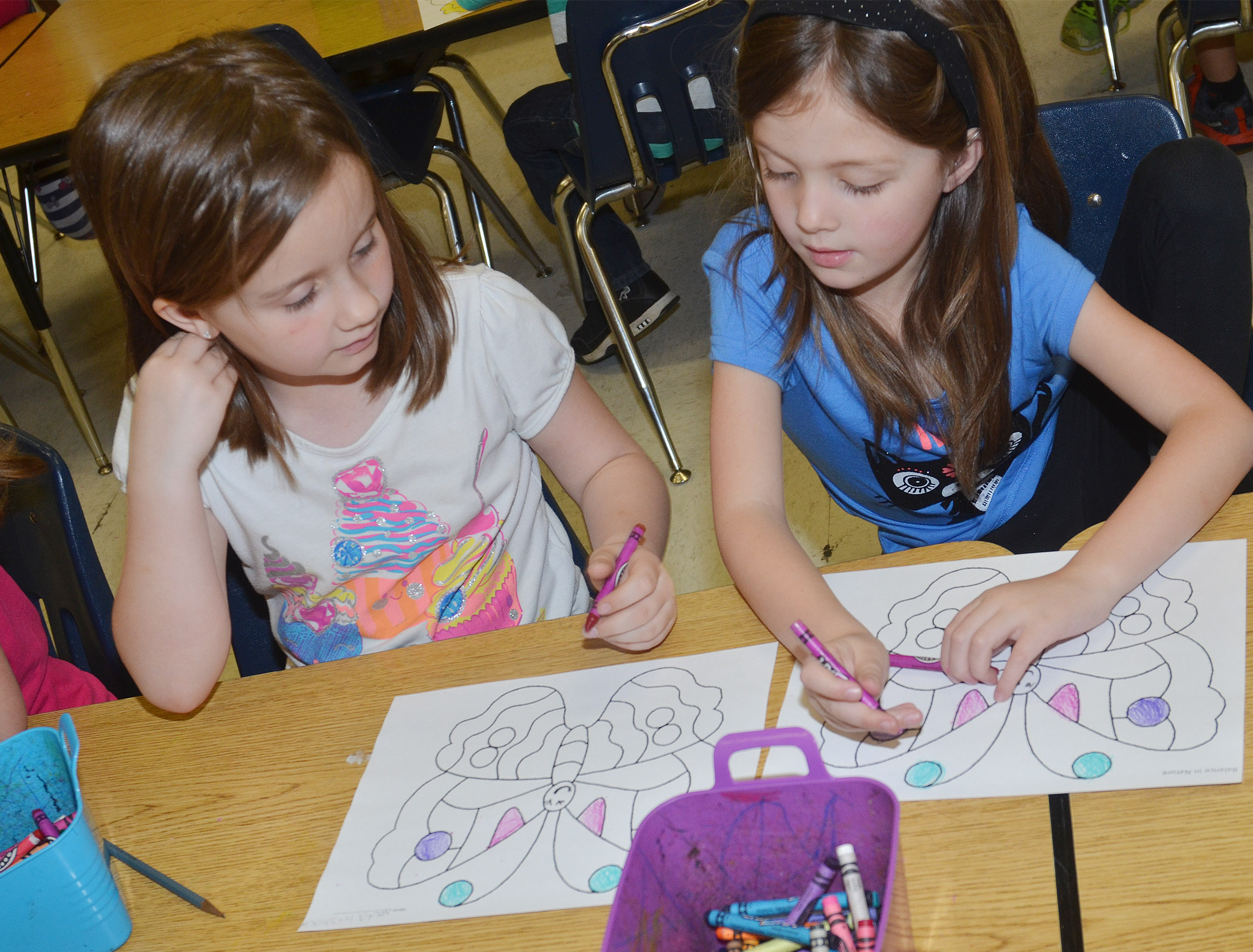 CES kindergarteners Natalee Shaw, at left, and Delaney Staton talk about their butterflies.