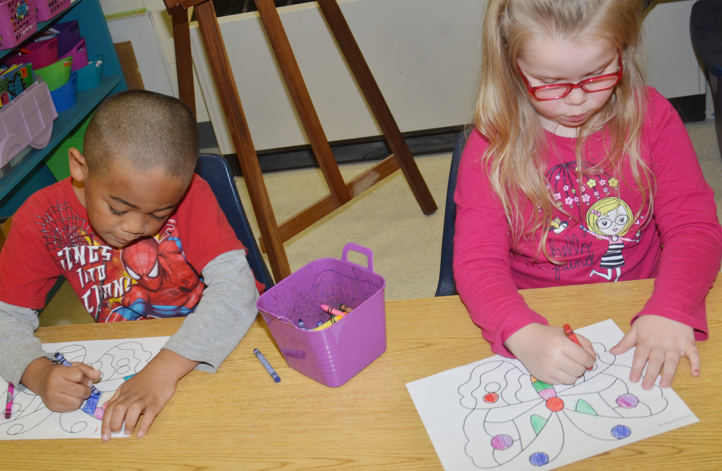 CES kindergarteners Tyler Branch, at left, and Cera Rooker color their butterflies.