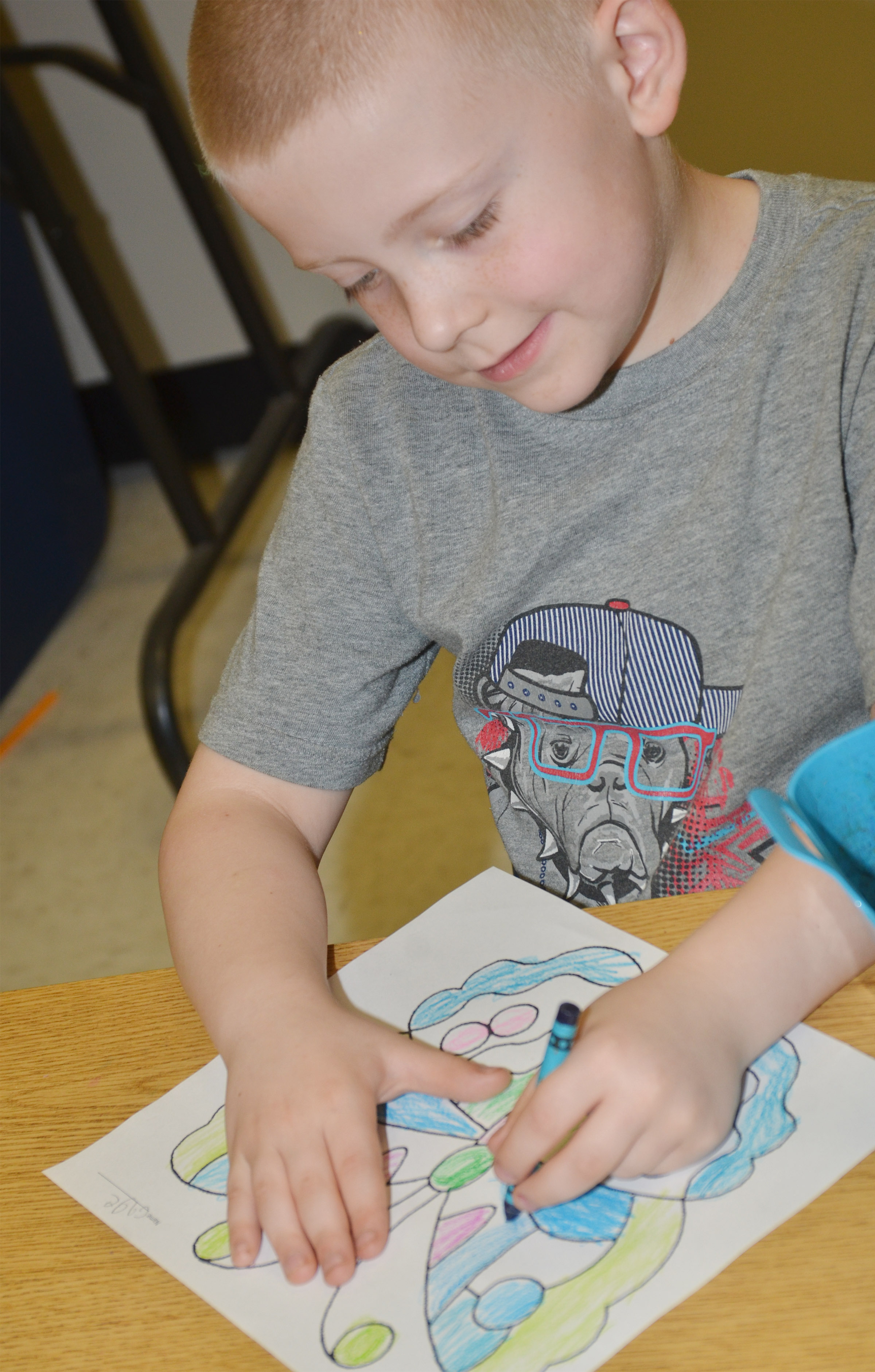 CES kindergartener Gage Henderson colors his butterfly.