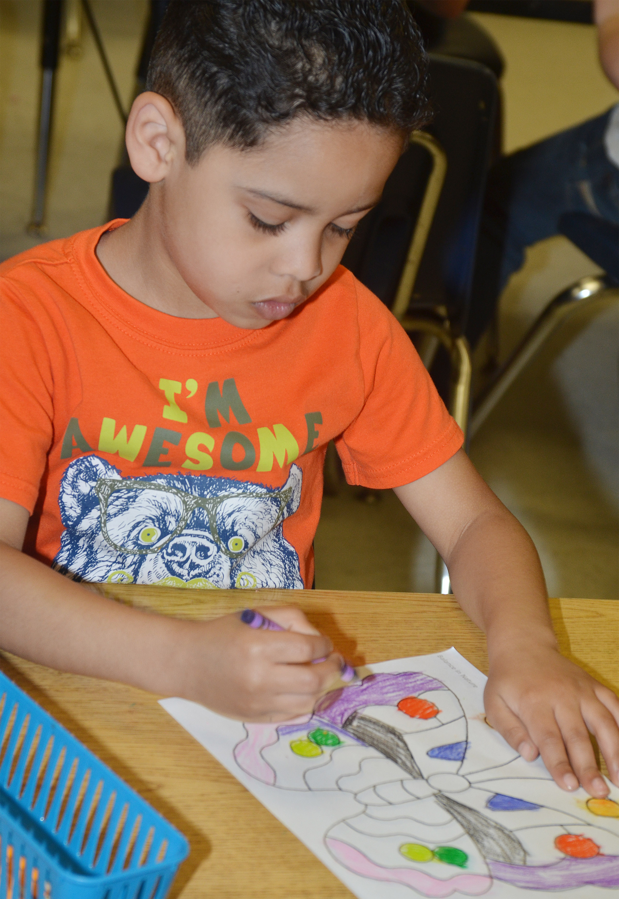 CES kindergartener Demarcus Noyola colors his butterfly.