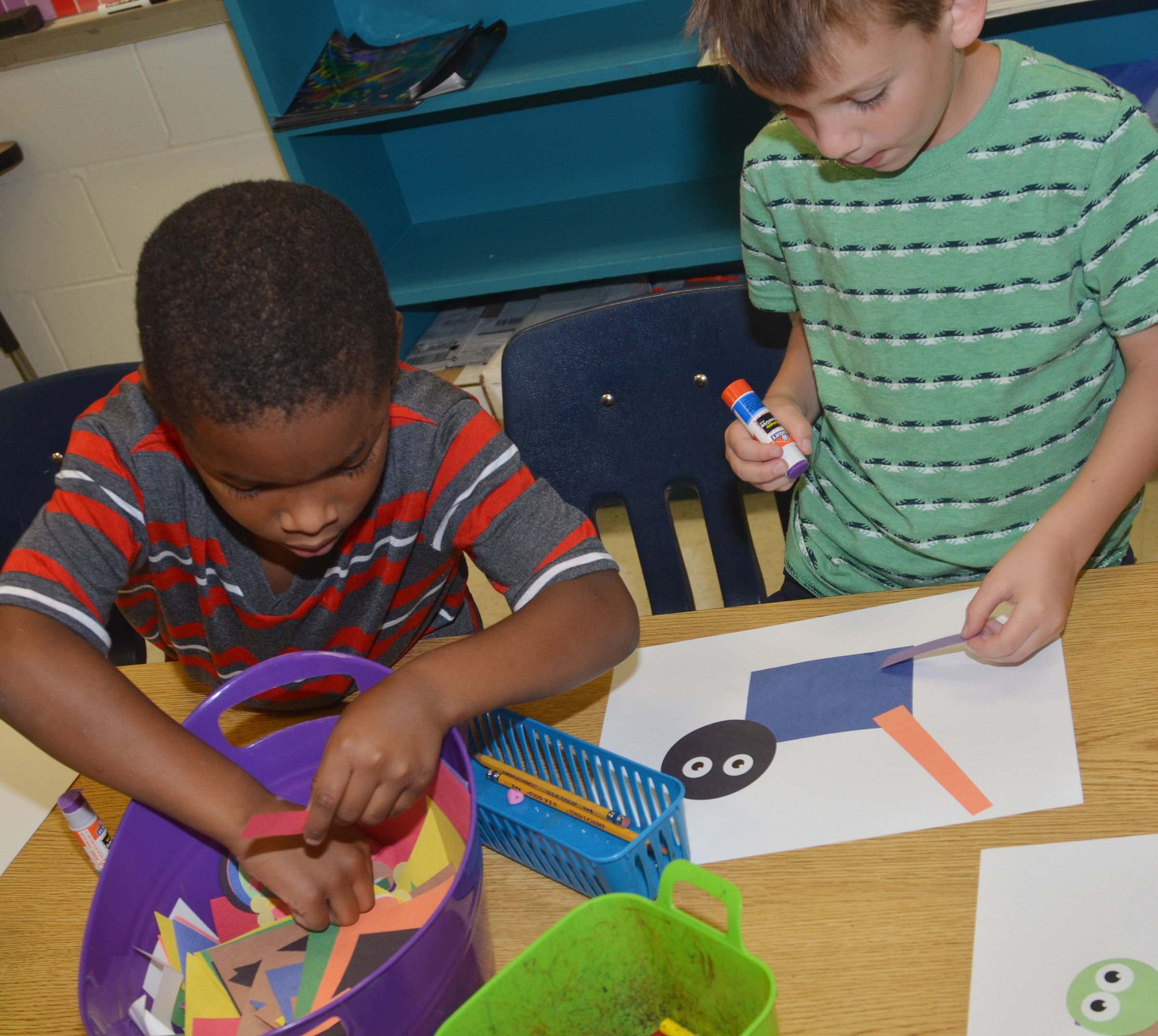 CES kindergarteners Kaiyden Vancleave, at left, and Cash Davis make their shape animals.
