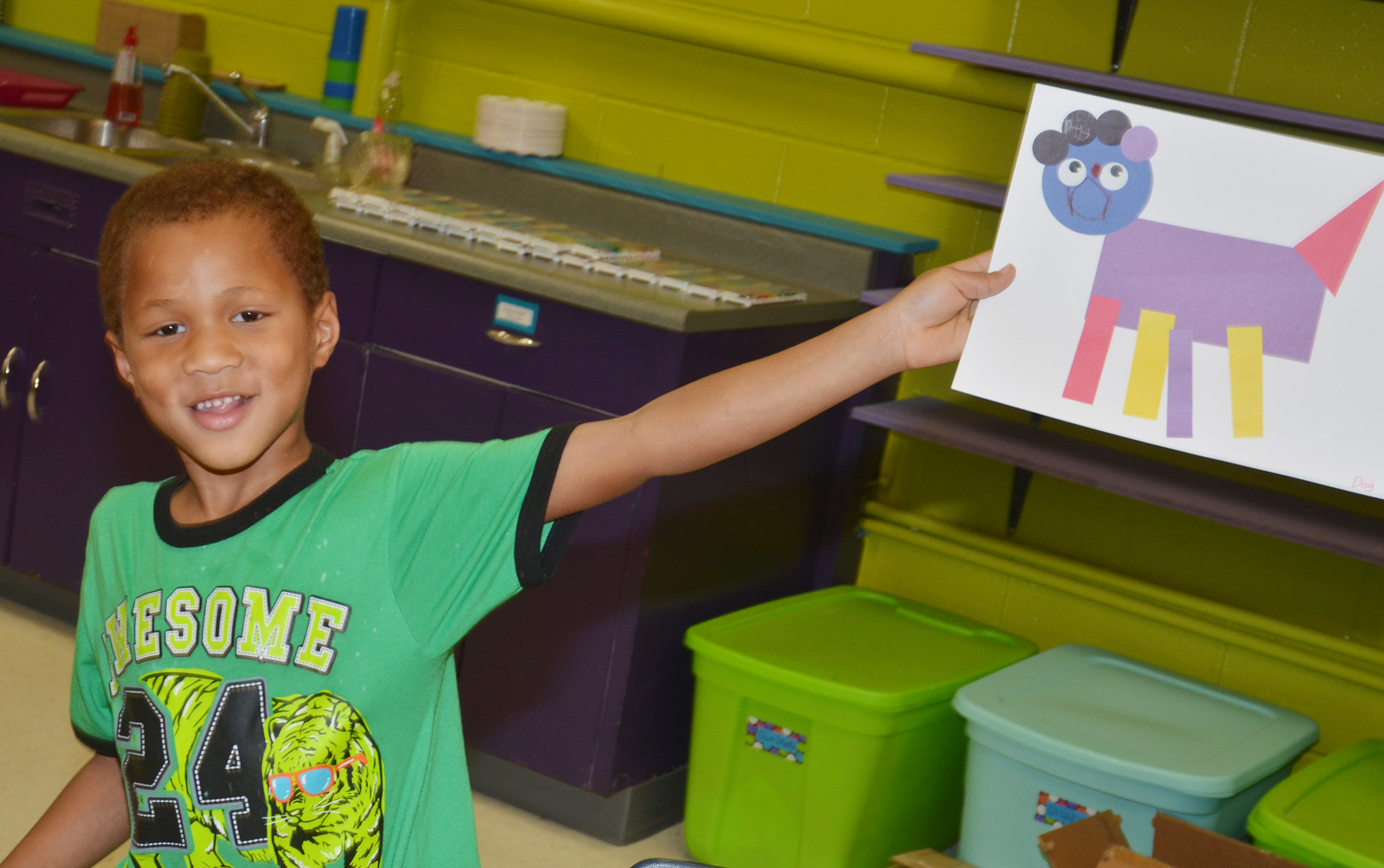CES kindergartener Jamerius Miller holds his shape animal.