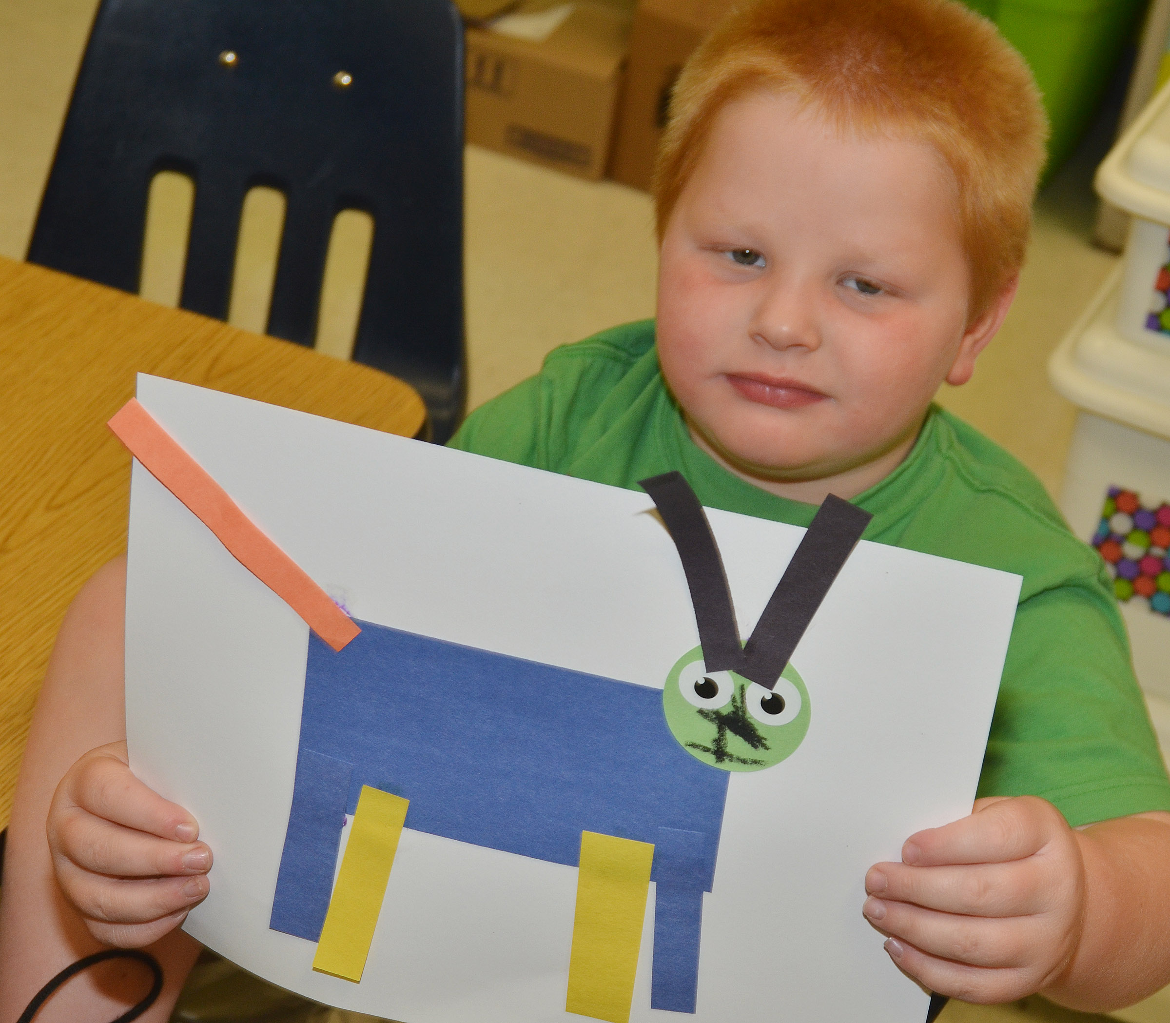 CES kindergartener Konnar Hicks holds his shape animal.