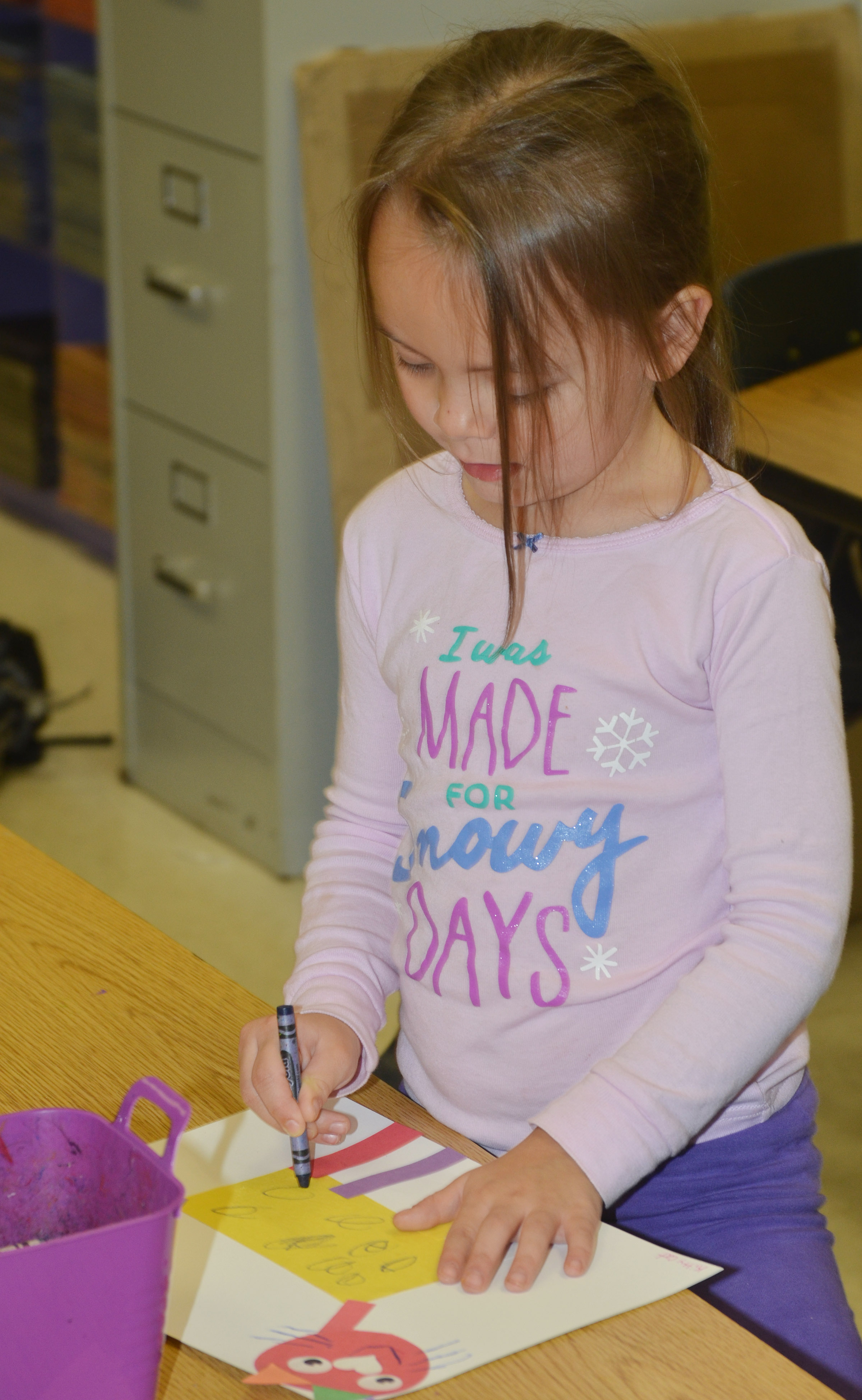 CES kindergartener Kalie Pilkington draws on her shape animal.