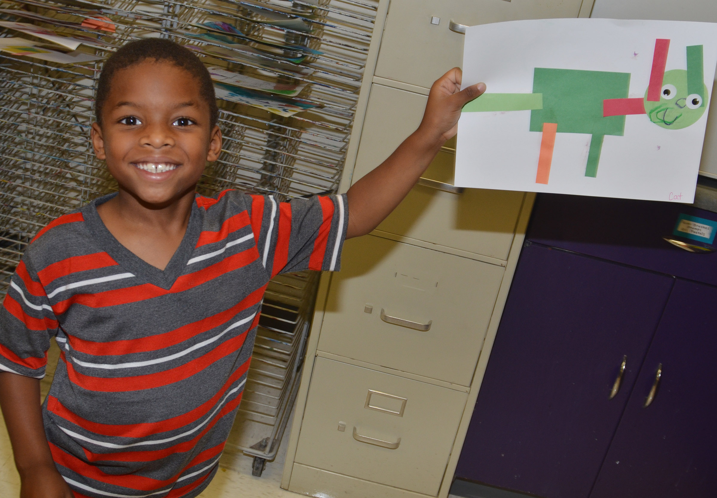 CES kindergartener Kaiyden Vancleave holds his shape animal.