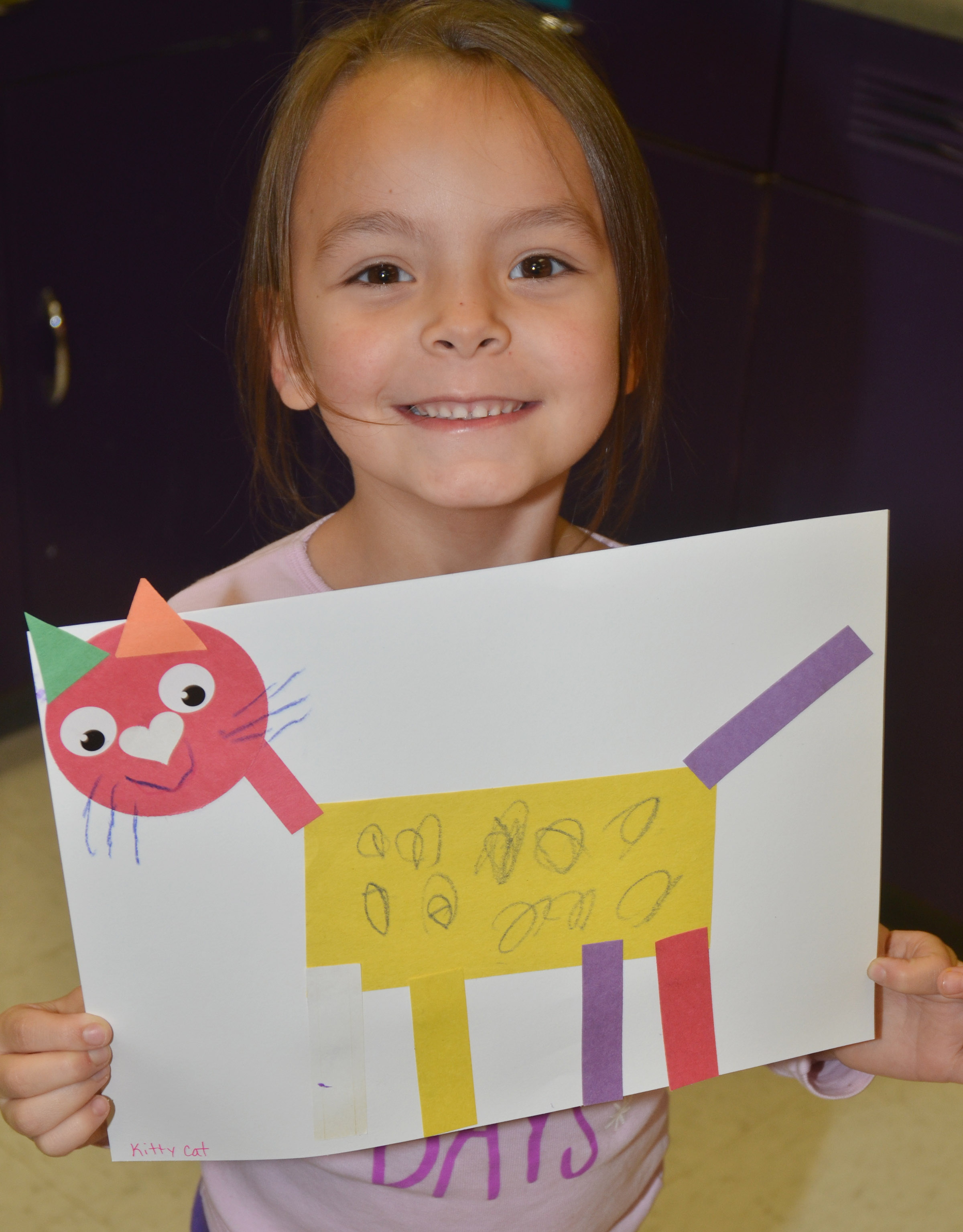 CES kindergartener Kalie Pilkington holds her shape animal.