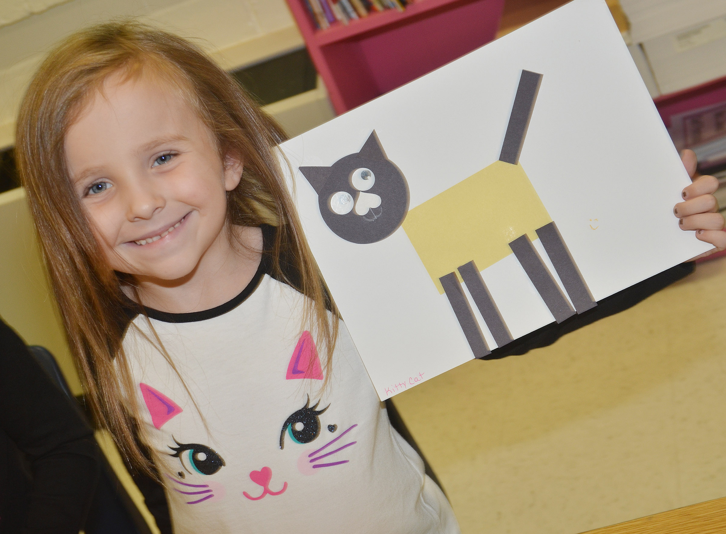 CES kindergartener Tabitha Leggett holds her shape animal.