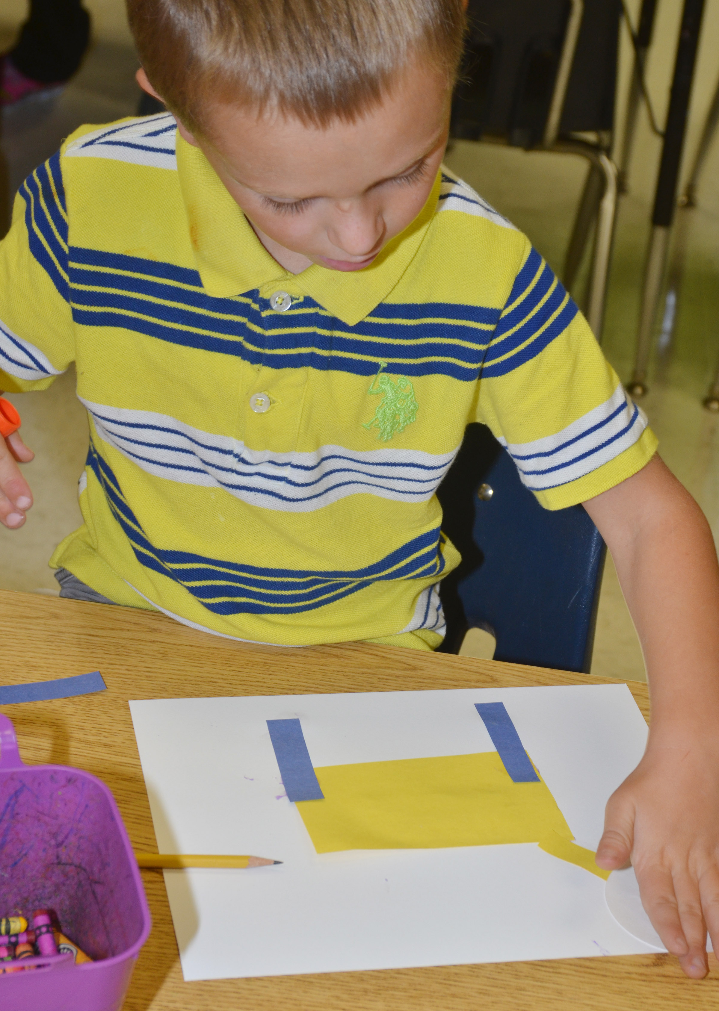 CES kindergartener Brayden Taylor makes his shape animal.