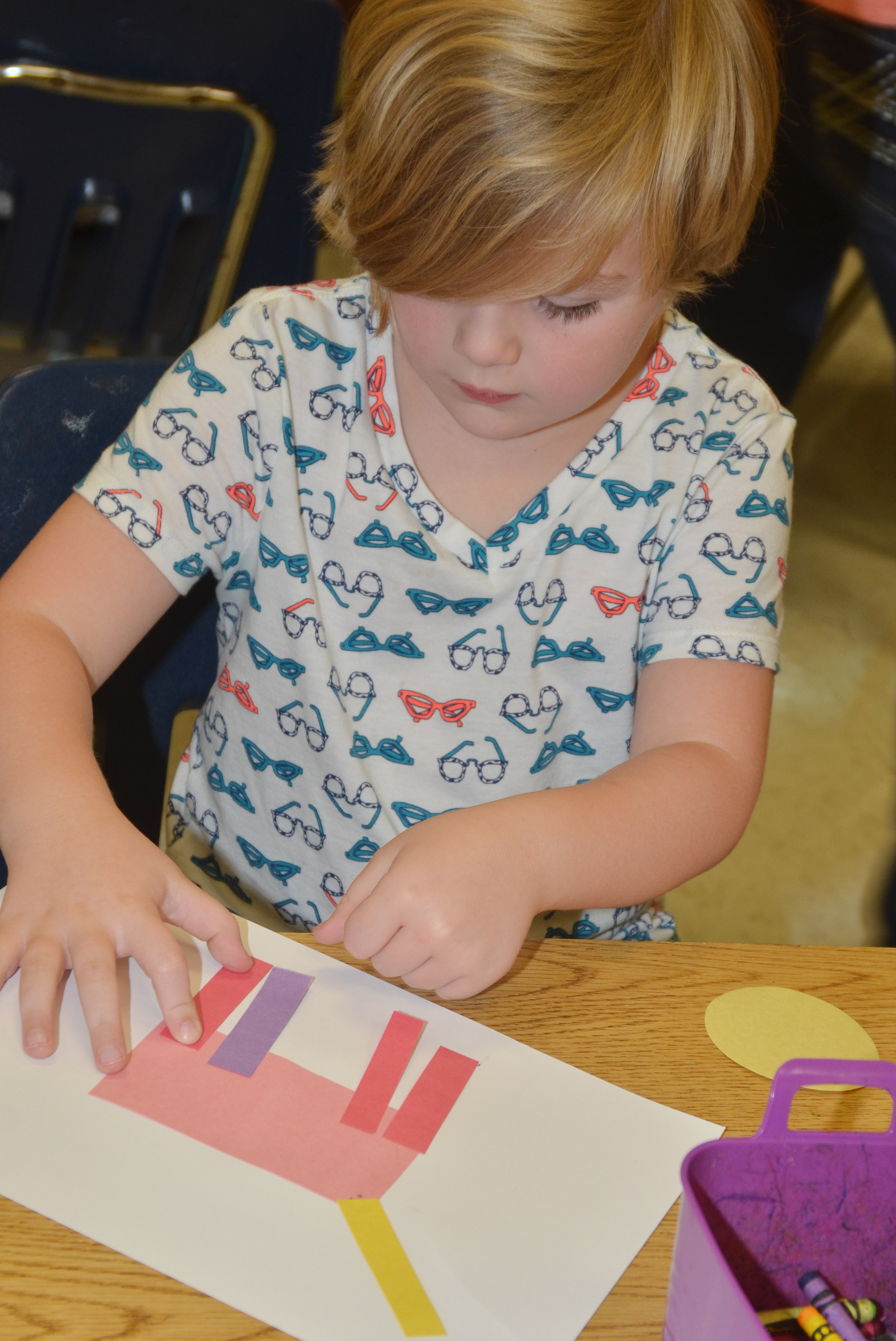 CES kindergartener Zoe Scharbrough makes her shape animal.