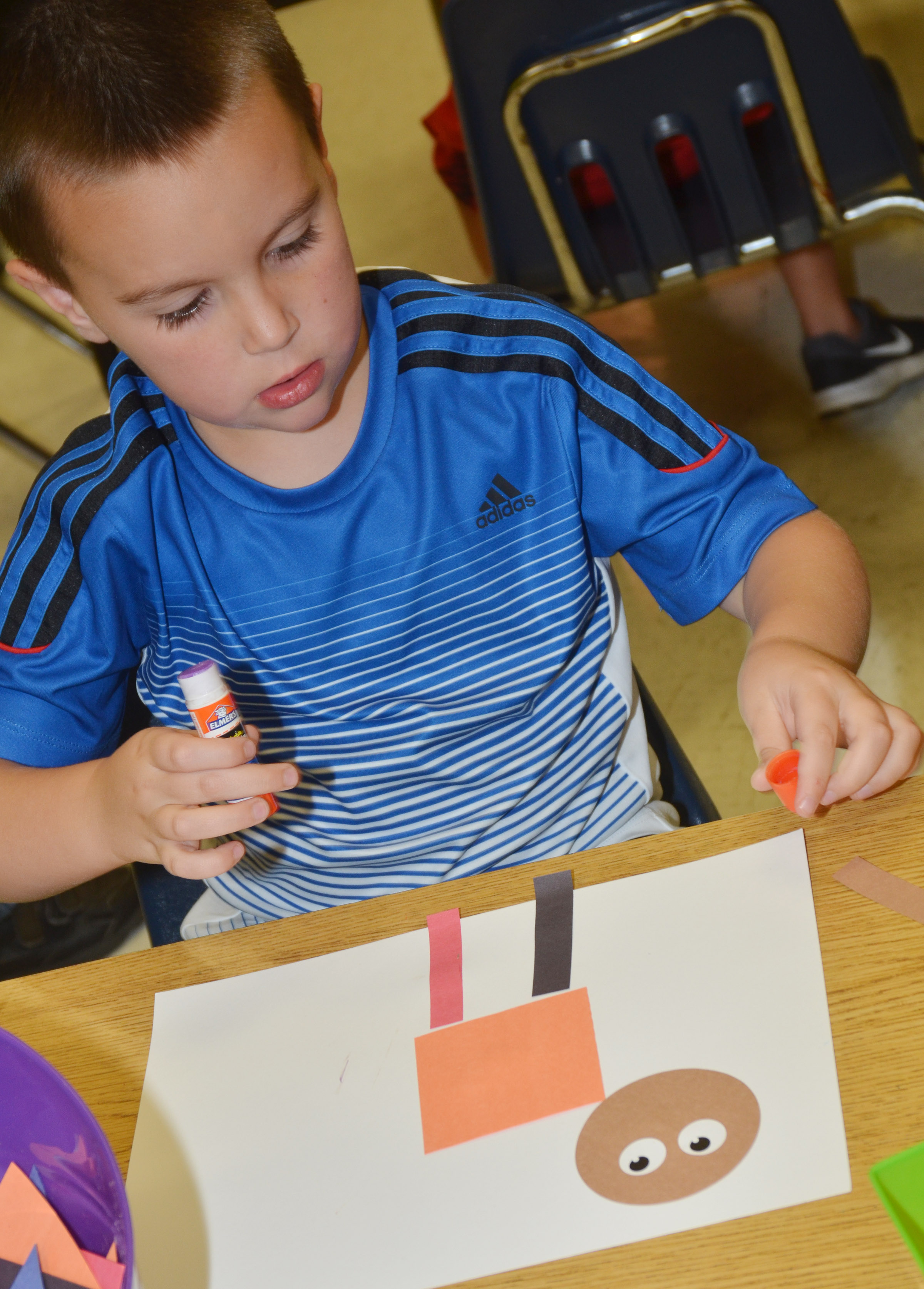 CES kindergartener Xander Britton glues together his shape animal.