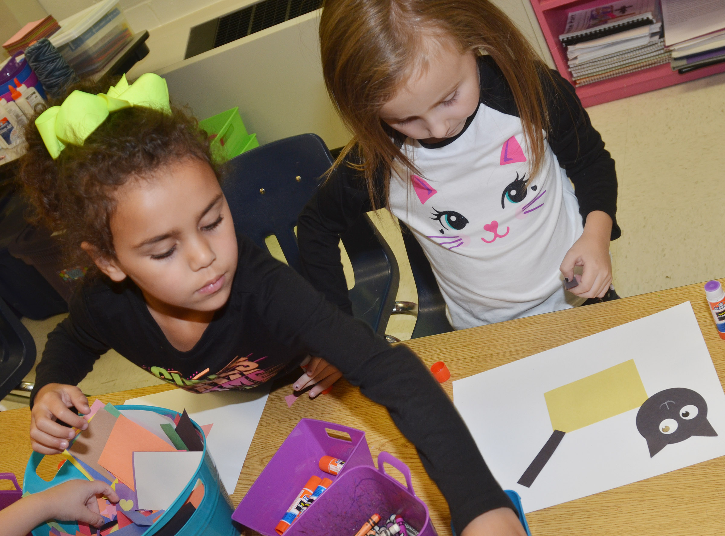 CES kindergarteners Adelyn Litsey, at left, and Tabitha Leggett make their shape animals.