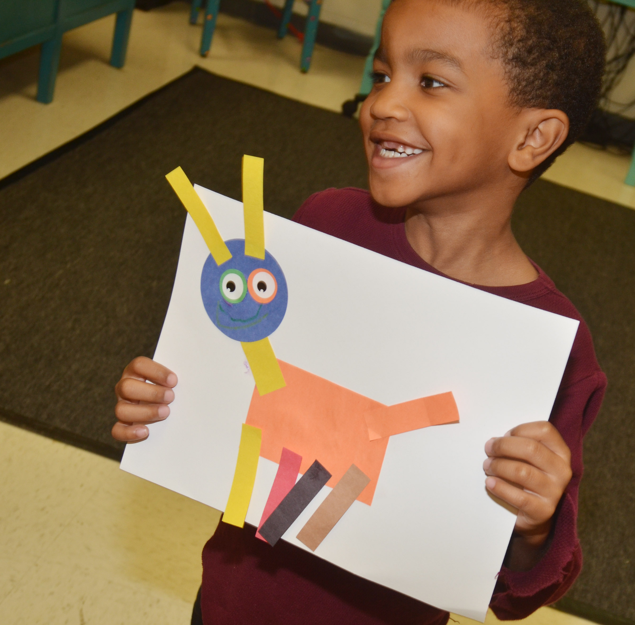 CES kindergartener Donavon Bell holds his shape animal.