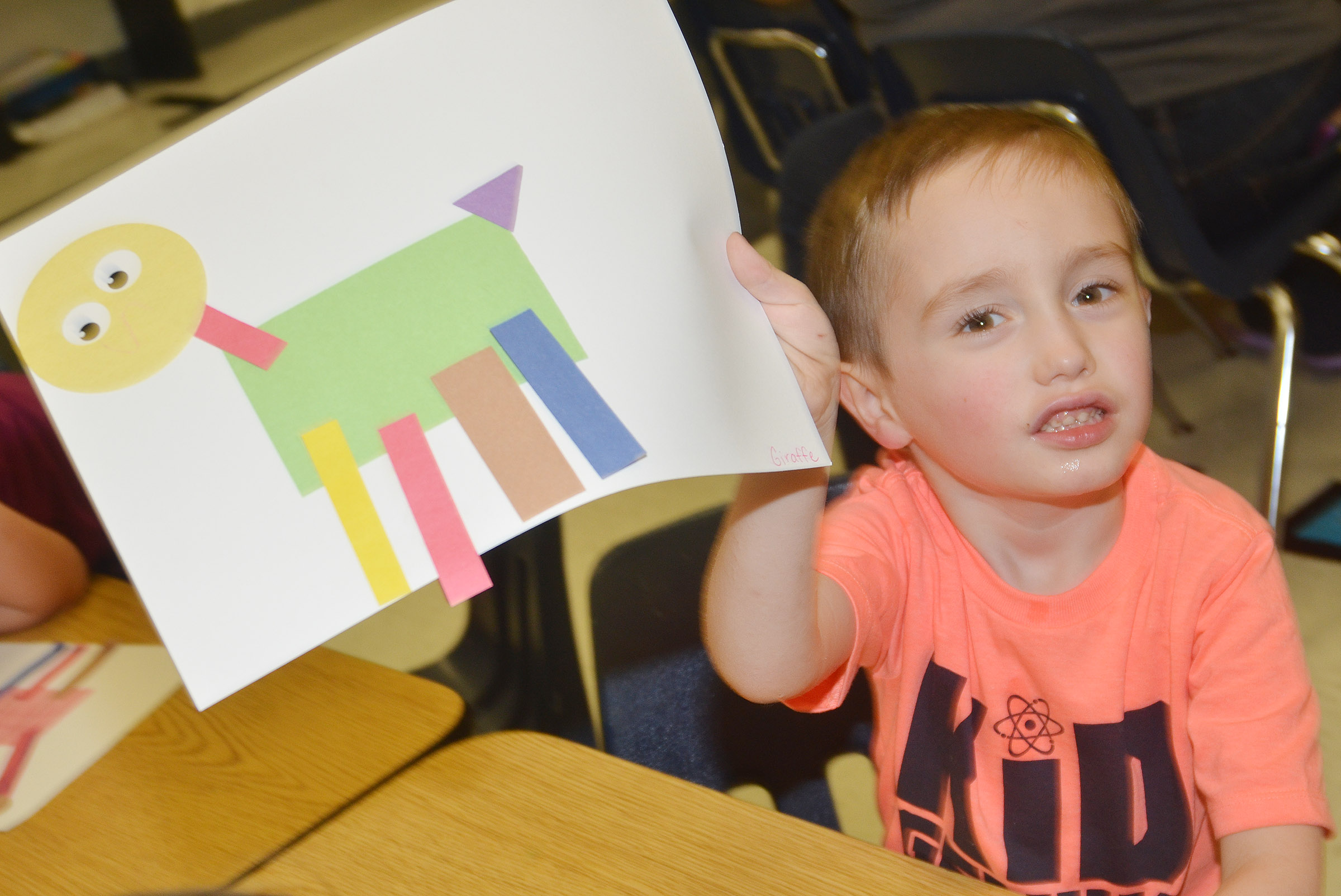 CES kindergartener Joshua Dickens holds his shape animal.
