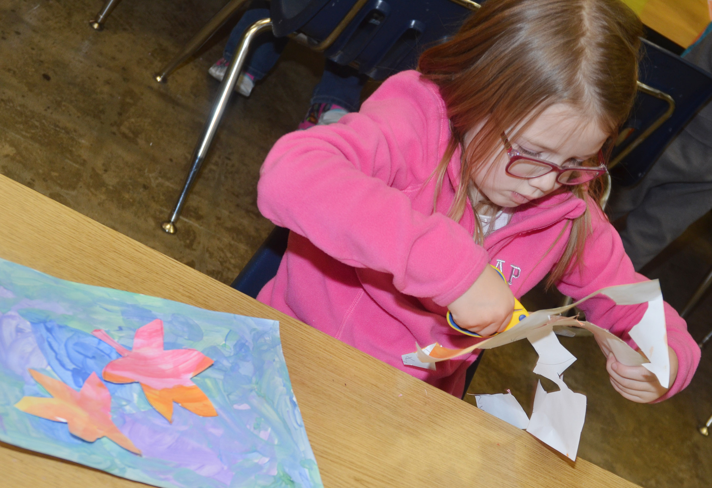CES kindergartener Emmaline Vespie cuts out her leaves.
