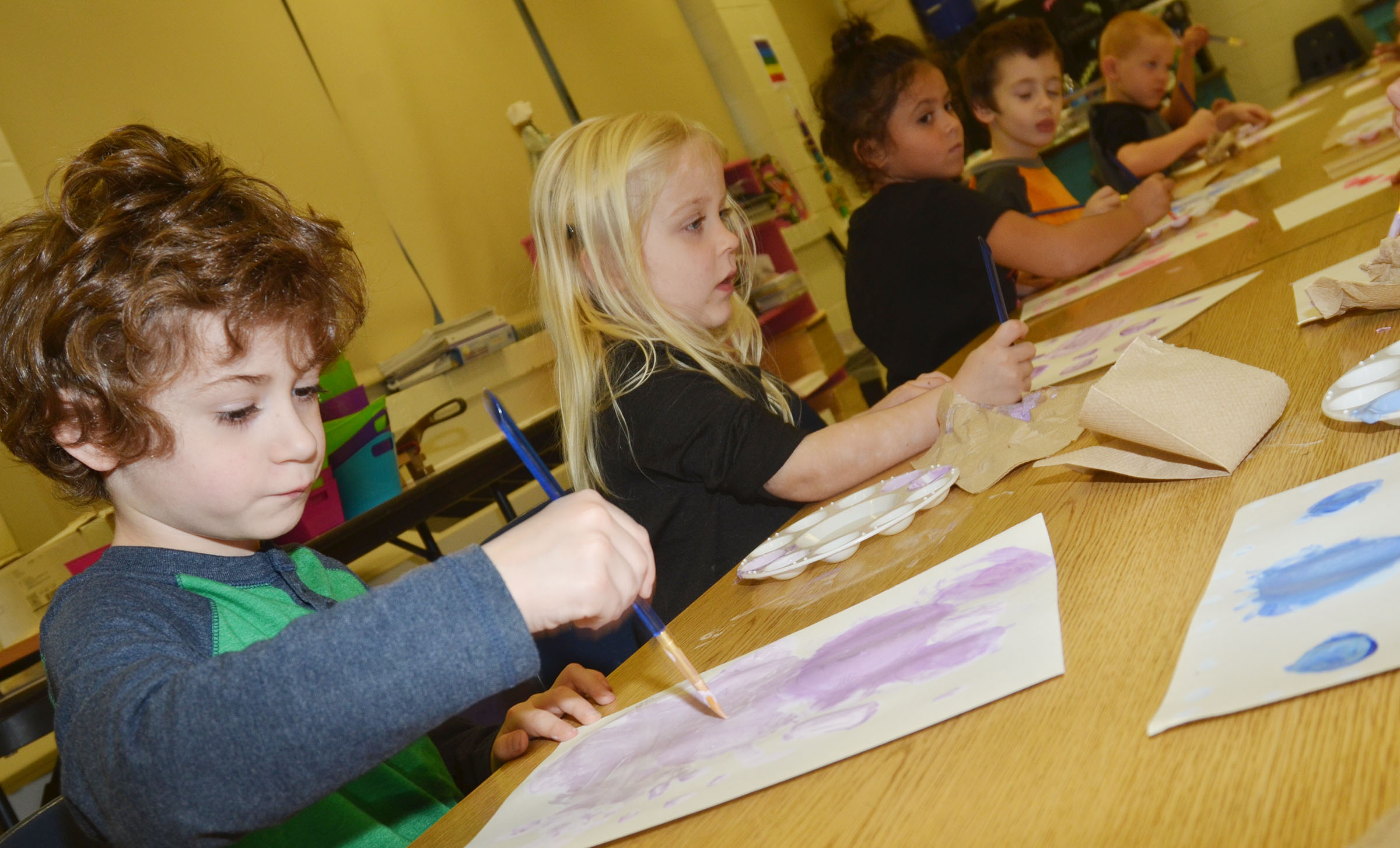 CES kindergartener Greyson Trulock paints circles after mixing a light shade of purple.