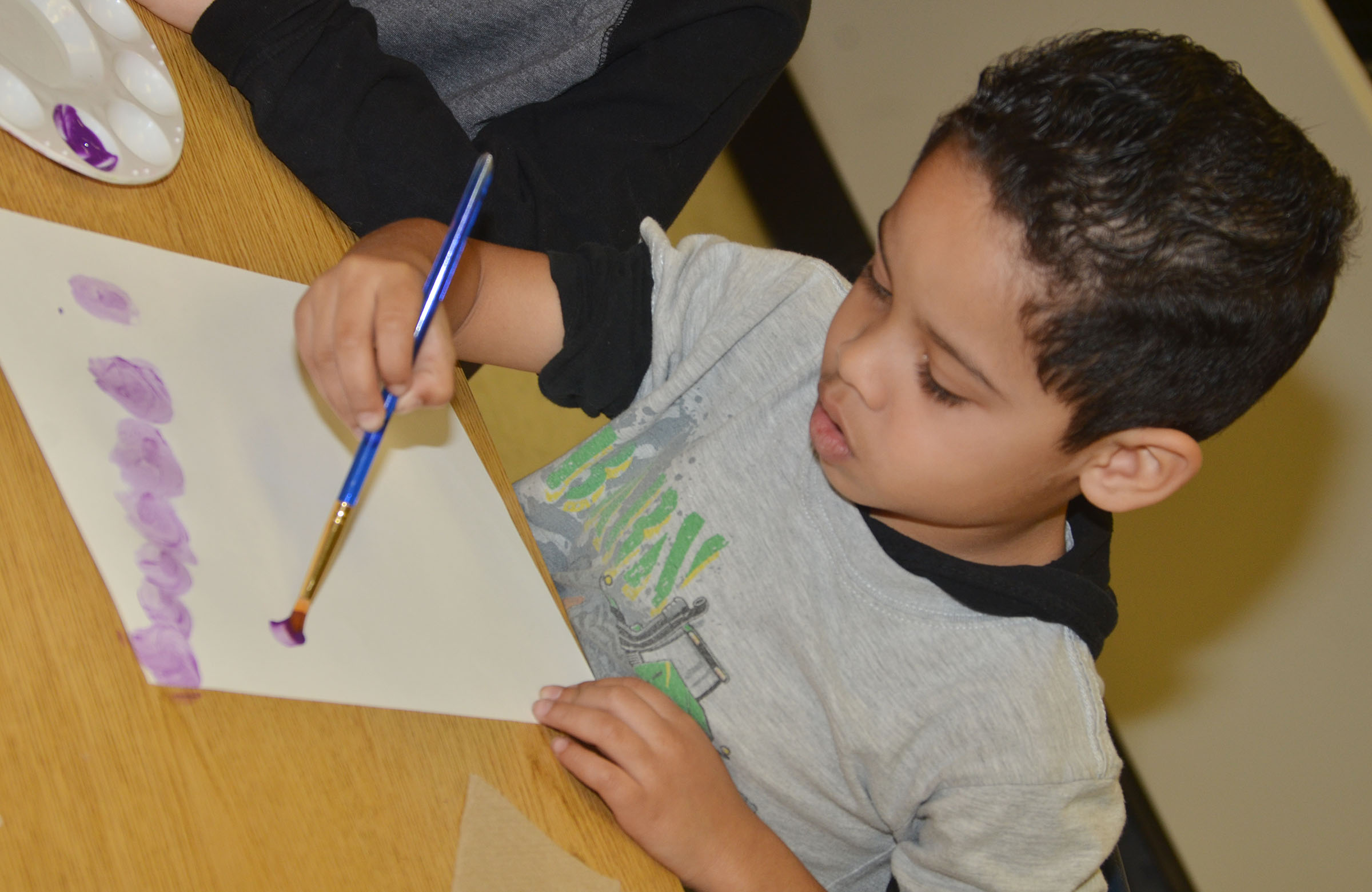 CES kindergartener Demarcus Noyola paints circles.