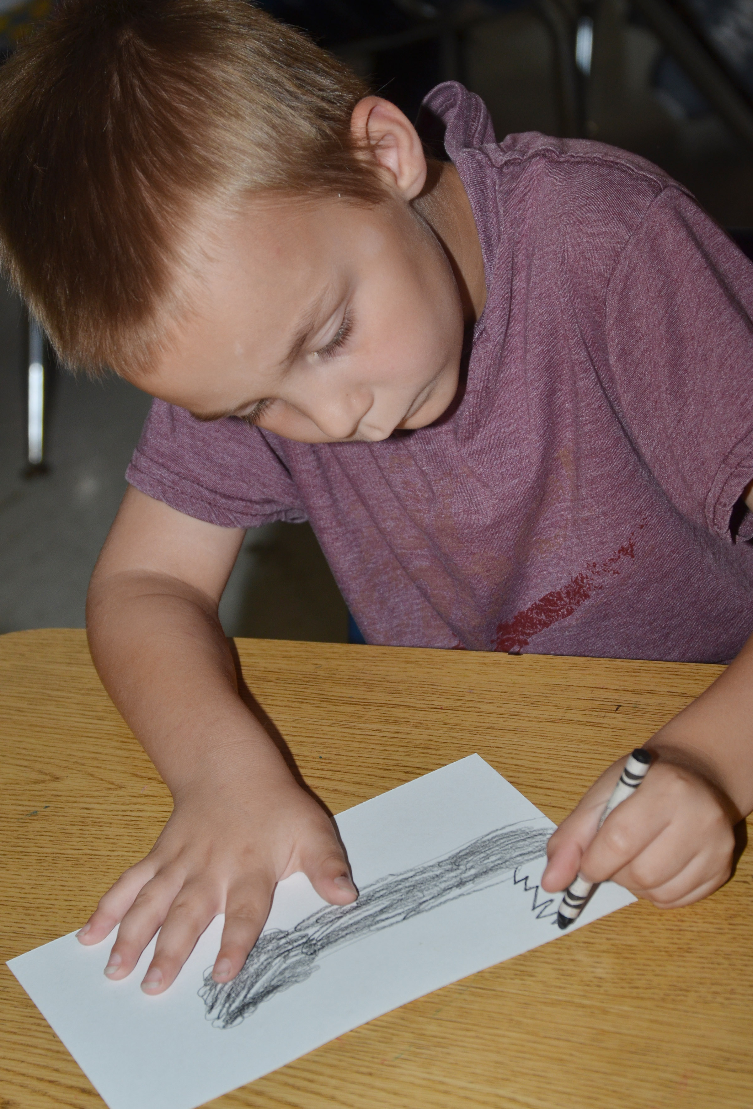 CES second-grader Hunter Bates draws his line tree.