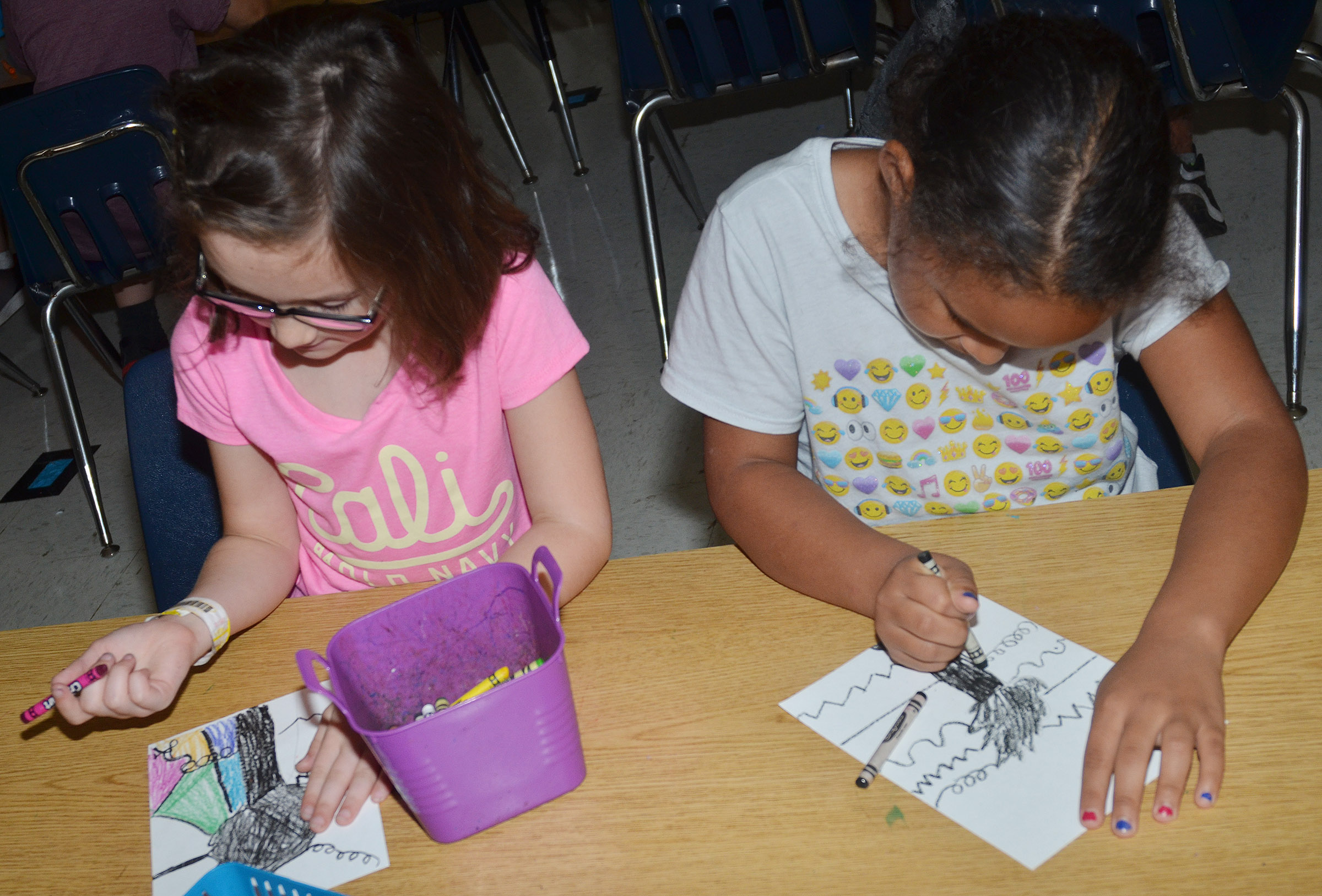CES second-grader Anna Keith, at left, and Amani Bridgewater color their line trees.