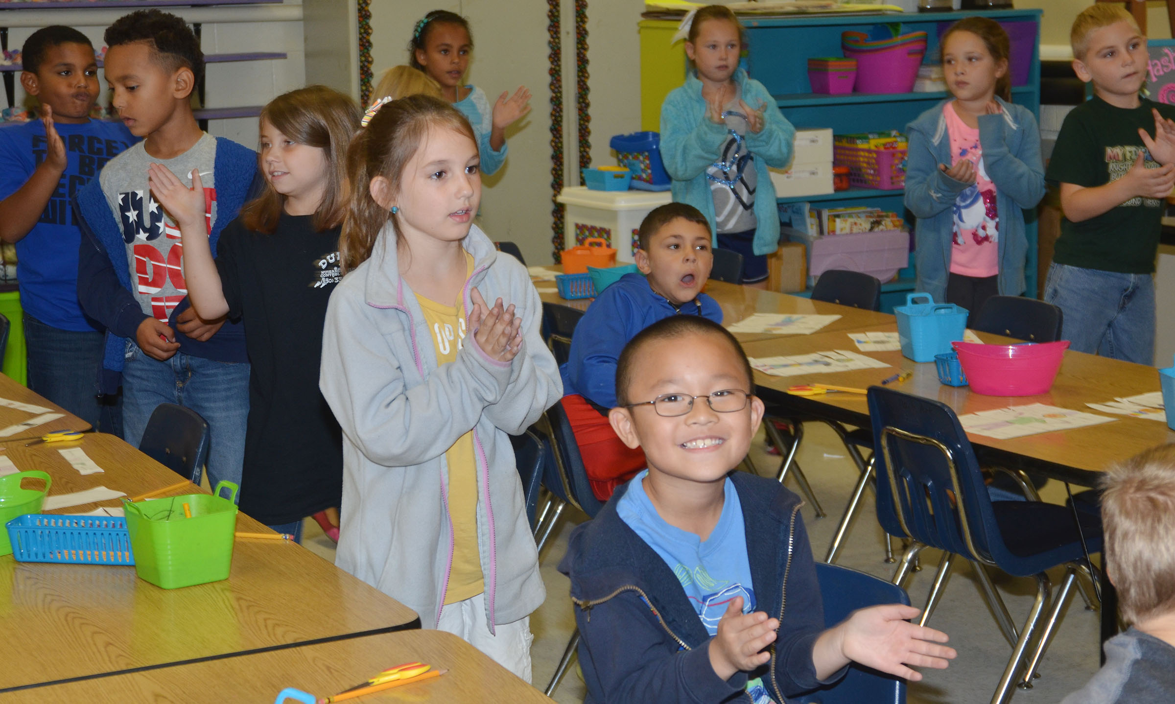 "CES second-graders sign and dance along to ""The Little Old Lady Who Was Not Afraid of Anything."""