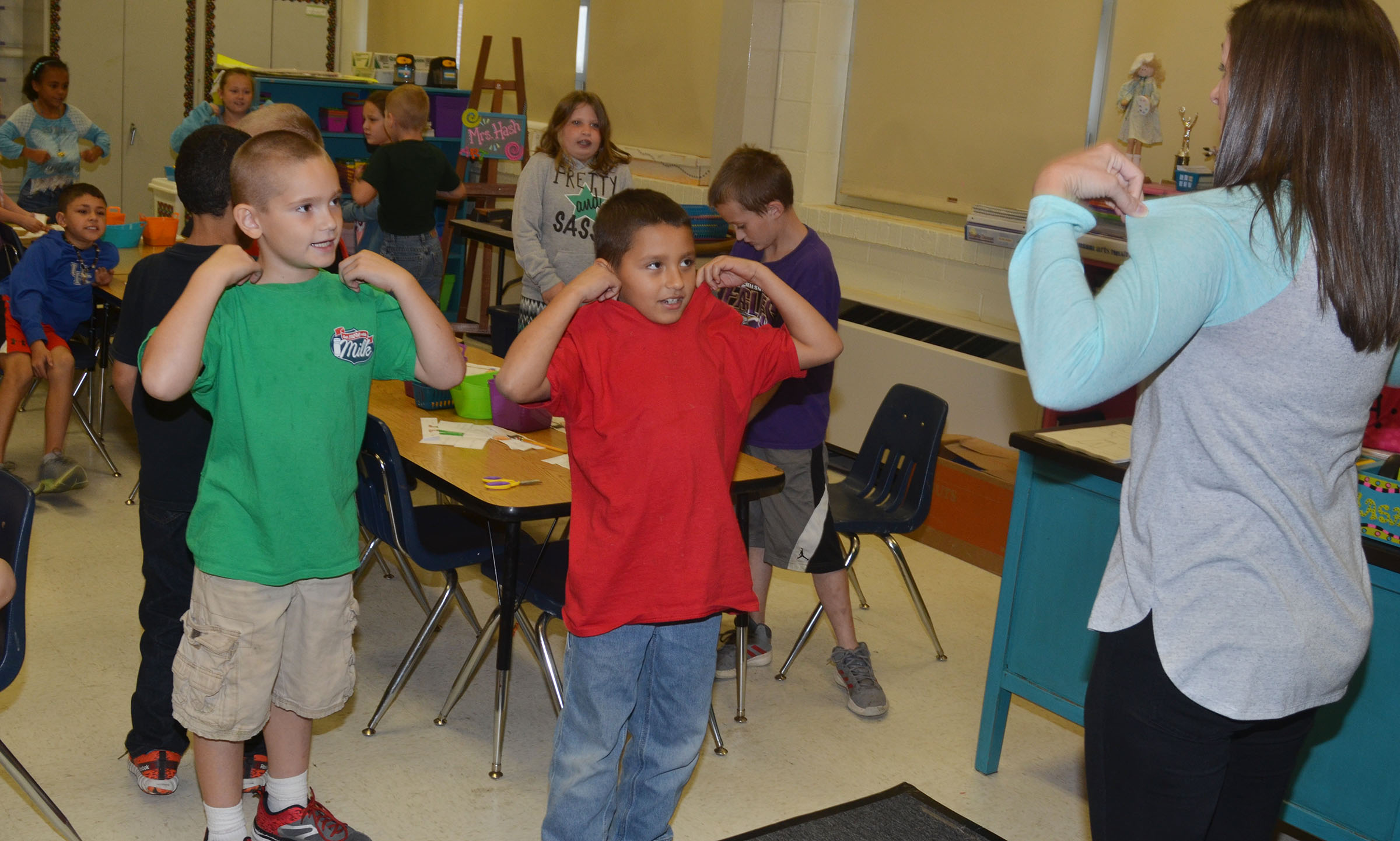 "CES art teacher Adrienne Hash leads second-graders in singing and dancing to ""The Little Old Lady Who Was Not Afraid of Anything."""