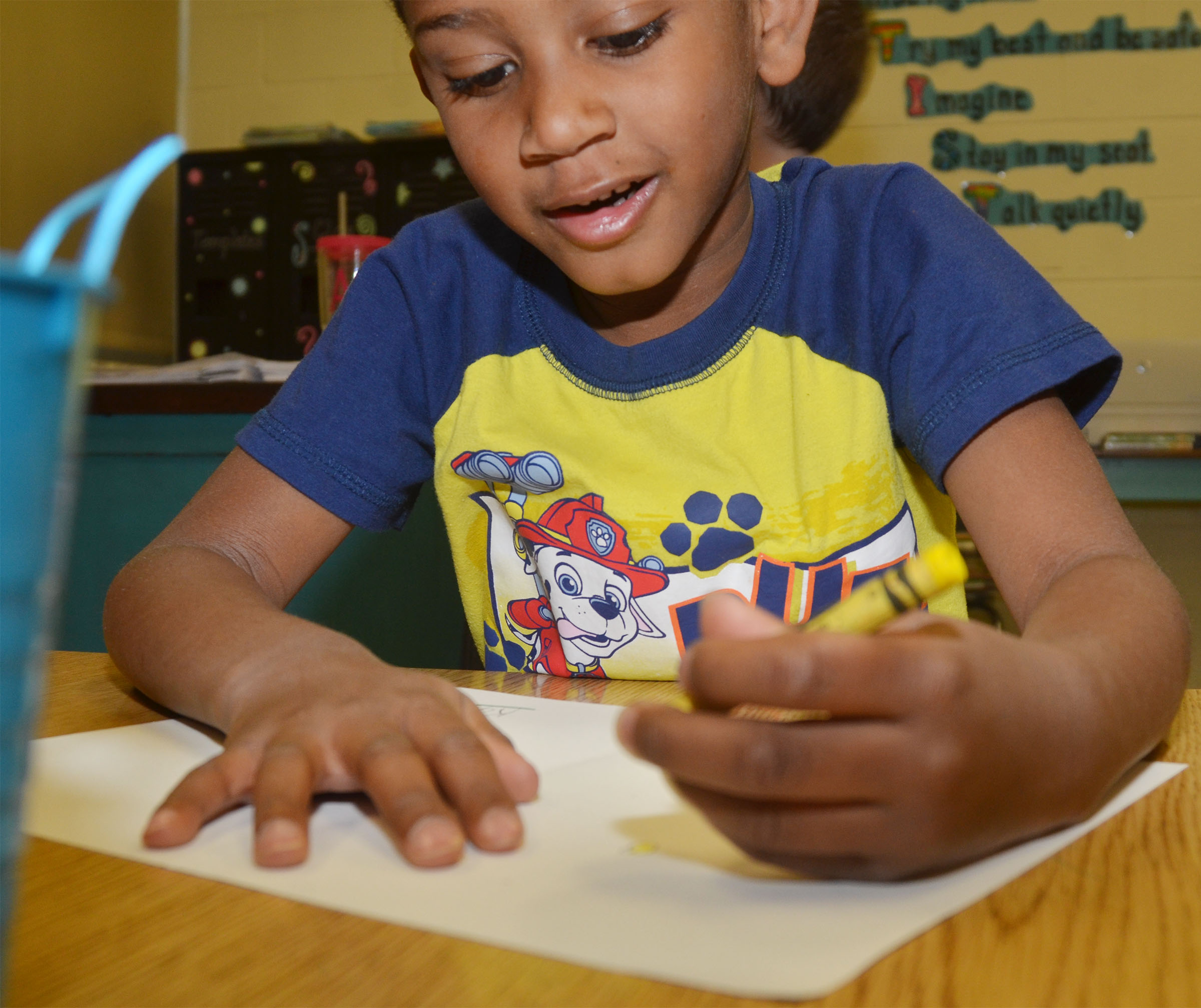 CES kindergartener Kasen Smith colors his Mother's Day card.