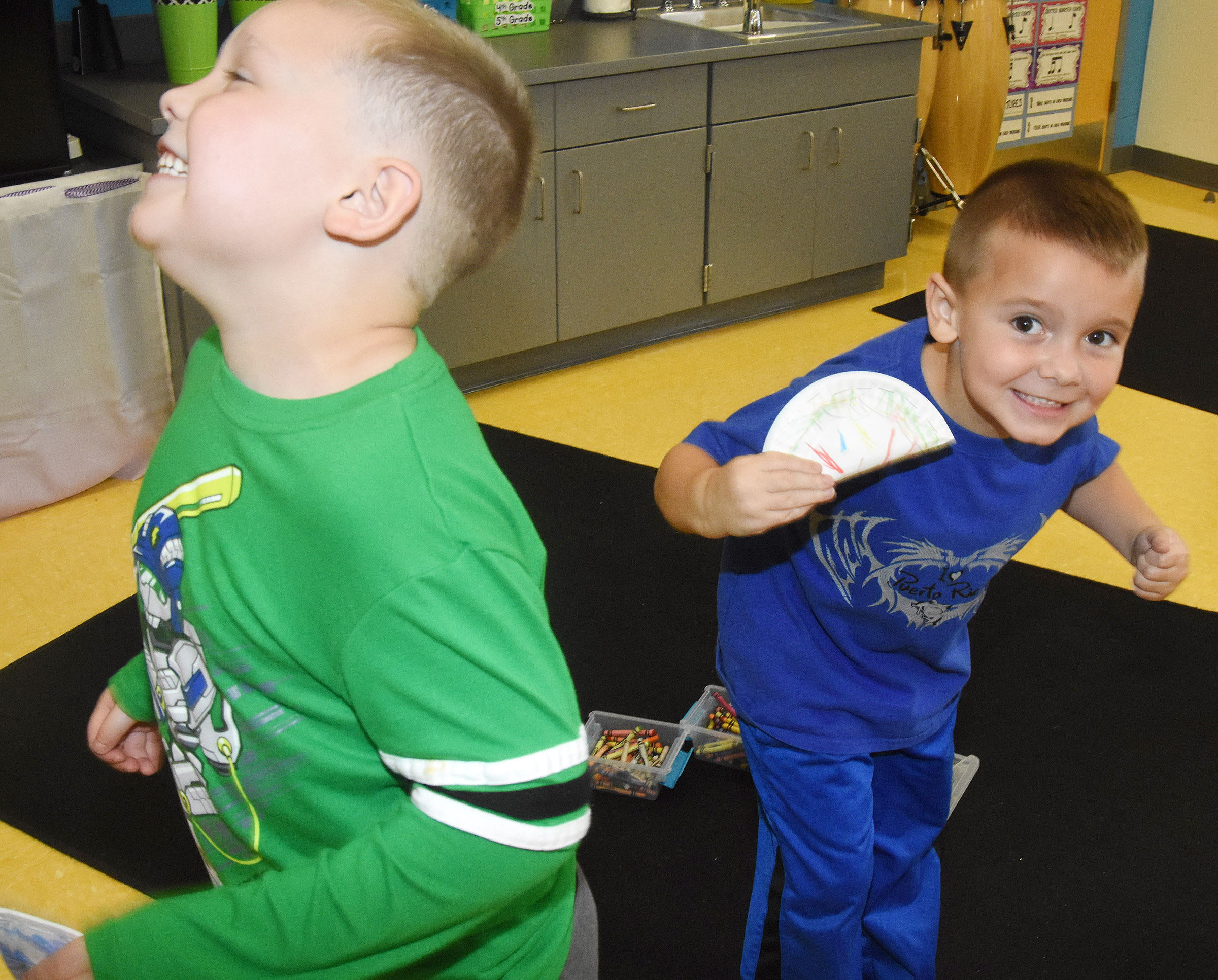 CES kindergarteners Zayden Walker, at left, and Colton Shaw dance as they play their shakers.