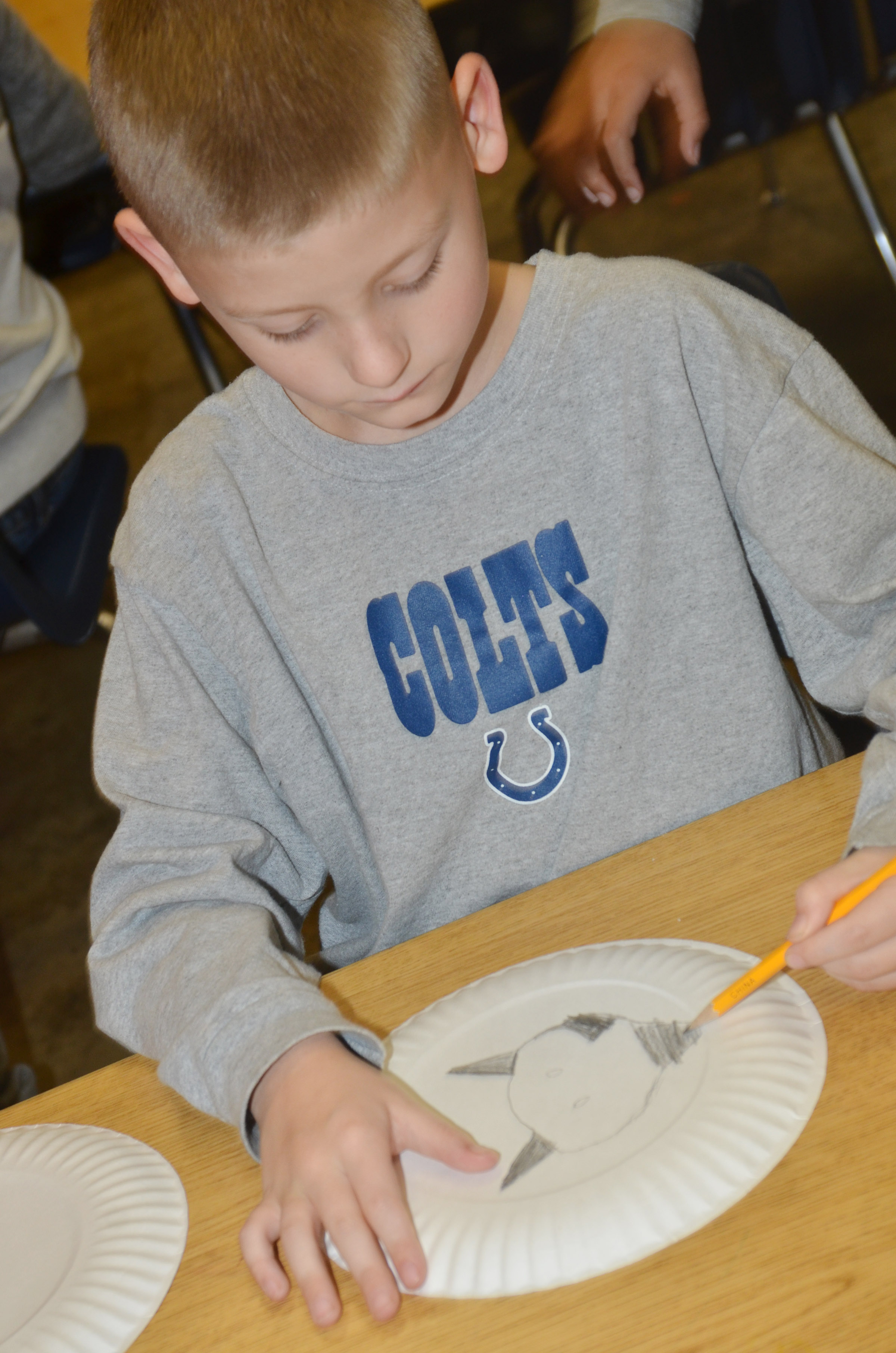 CES third-grader Malachi Sanford designs his Native American shield.