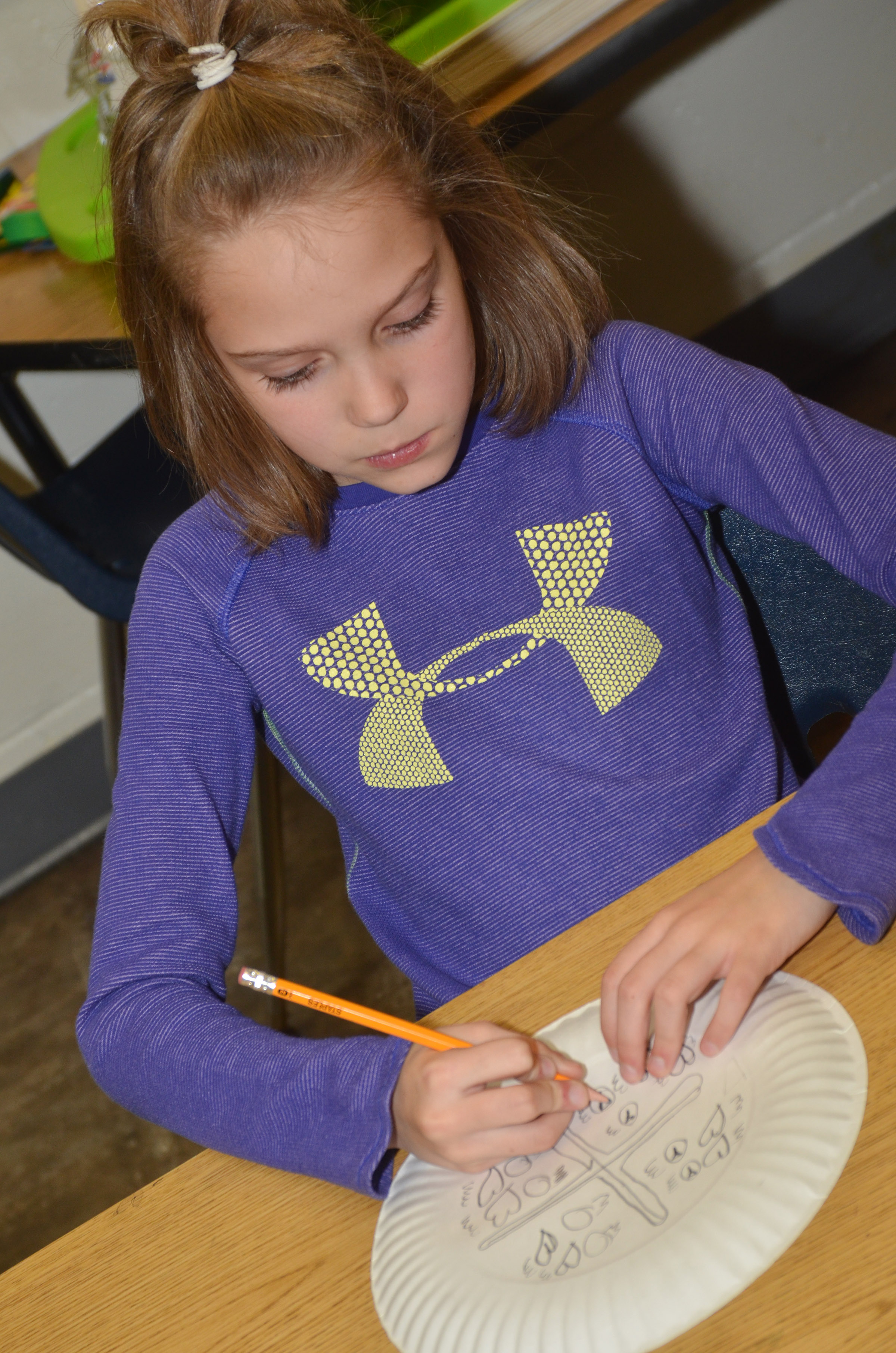 CES third-grader Baylee Pike designs her Native American shield.