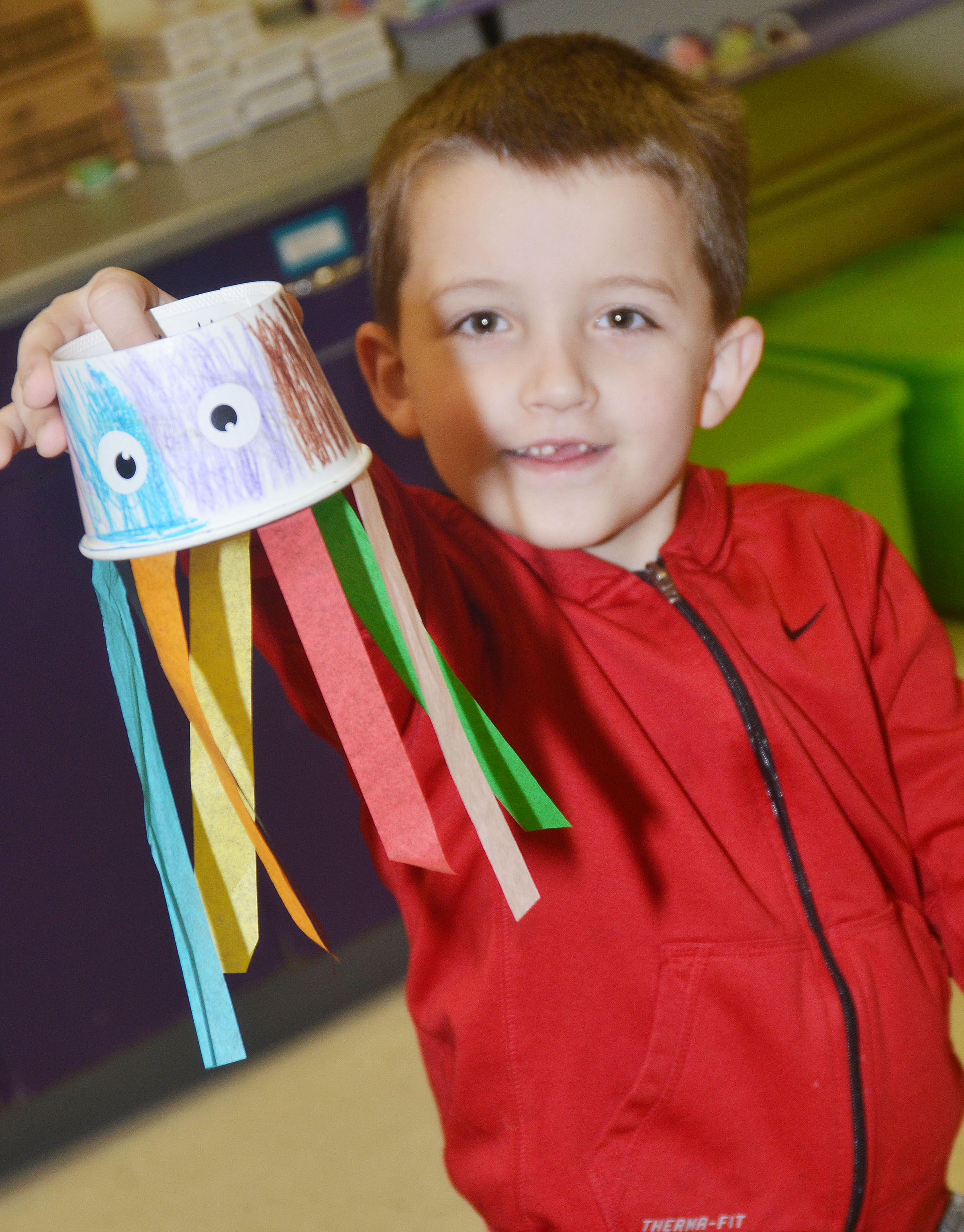 CES kindergartener Timothy Stacy holds his finished octopus.