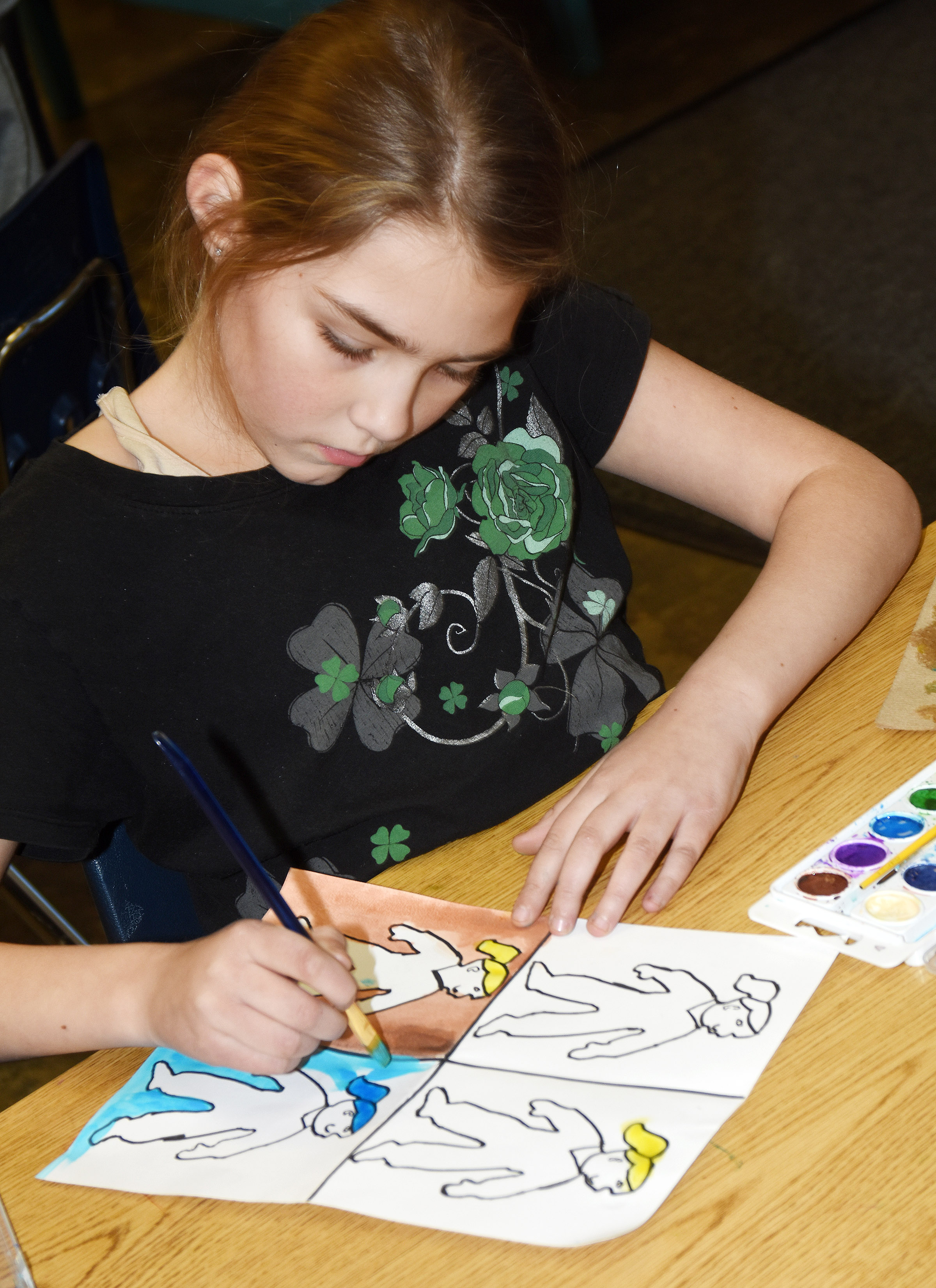 CES fifth-grader Harley Couch-Allen paints.