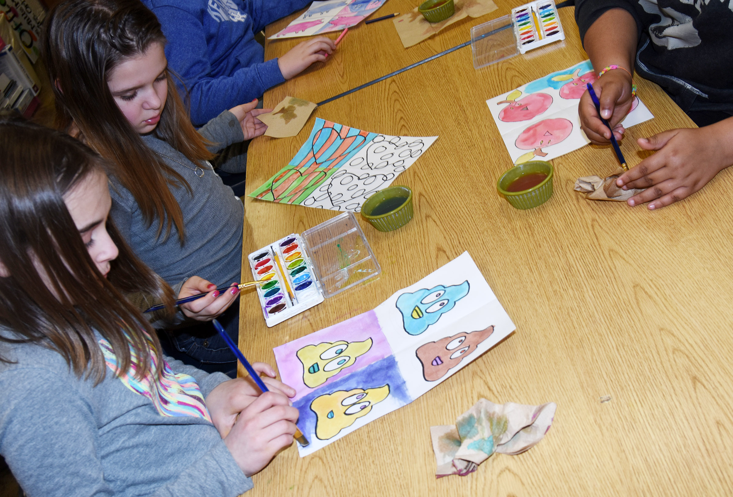 CES fifth-graders Anna Floyd, at left, and Natasha Torres paint their Pop Art.