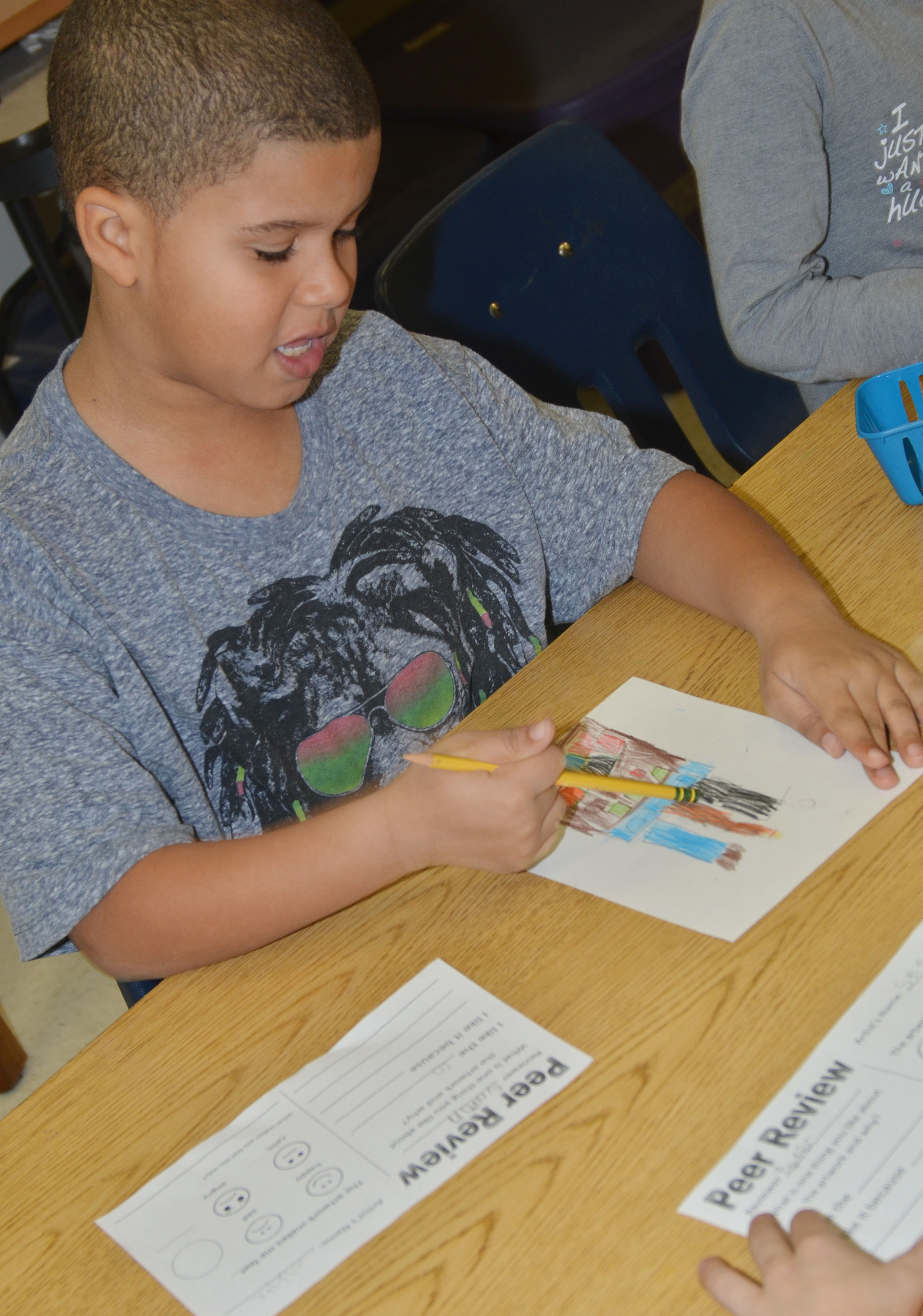 CES first-grader Navon Copeland writes a peer art review.
