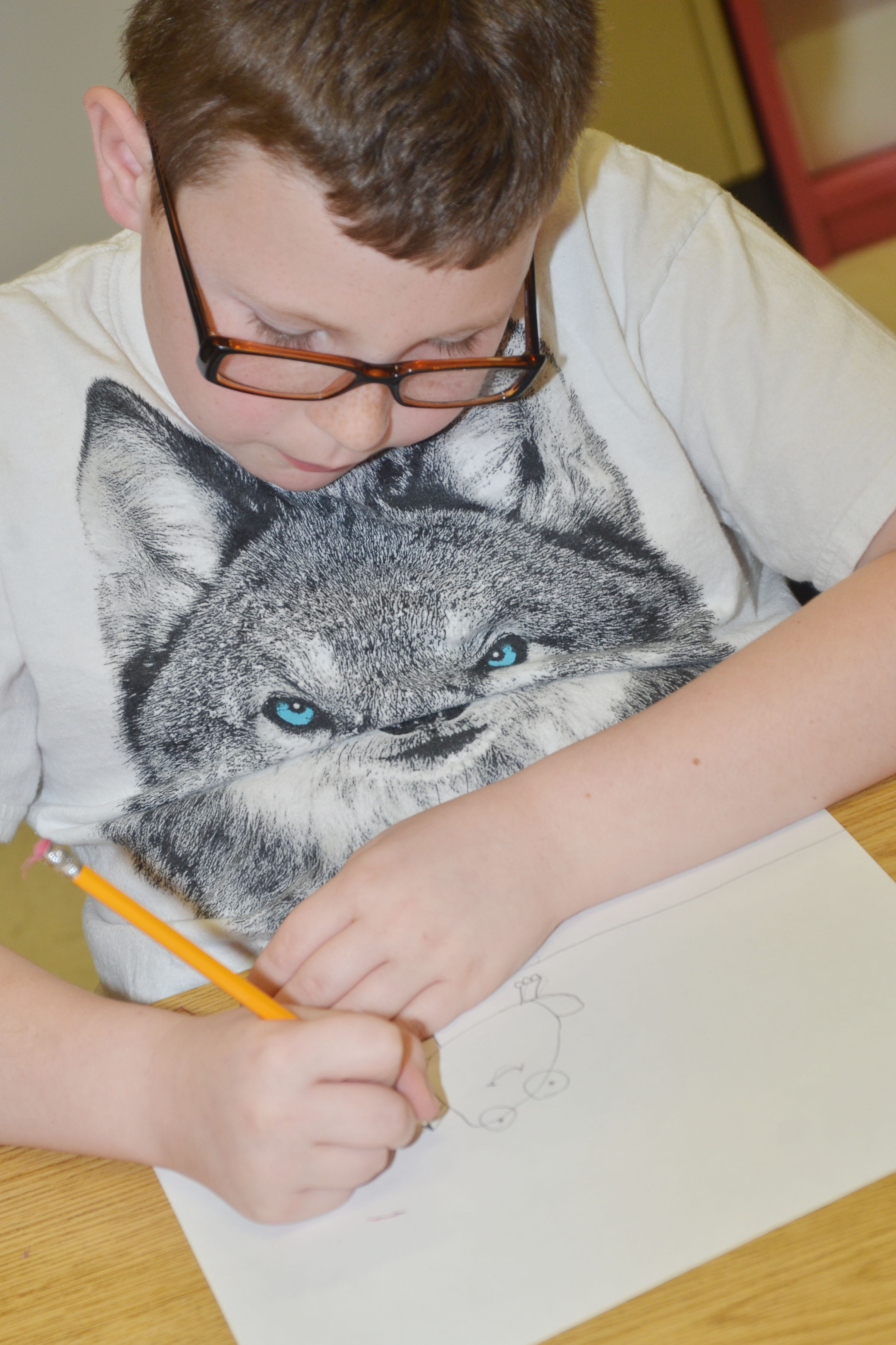 CES third-grader Lucas Gribbins draws his frog scene for the Save the Frogs contest.